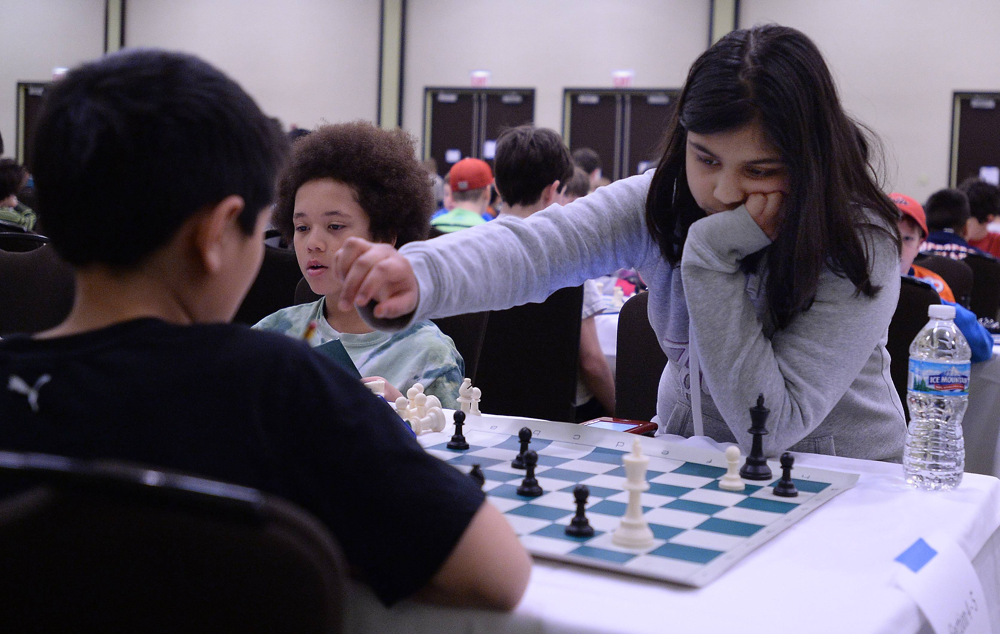 Shreya Mangalam, 10, of South Barrington, studies her opponent Matthew Li during the Illinois K-8 Chess Championships at the Hyatt Regency in Schaumburg last month. Shreya placed first in her age group.