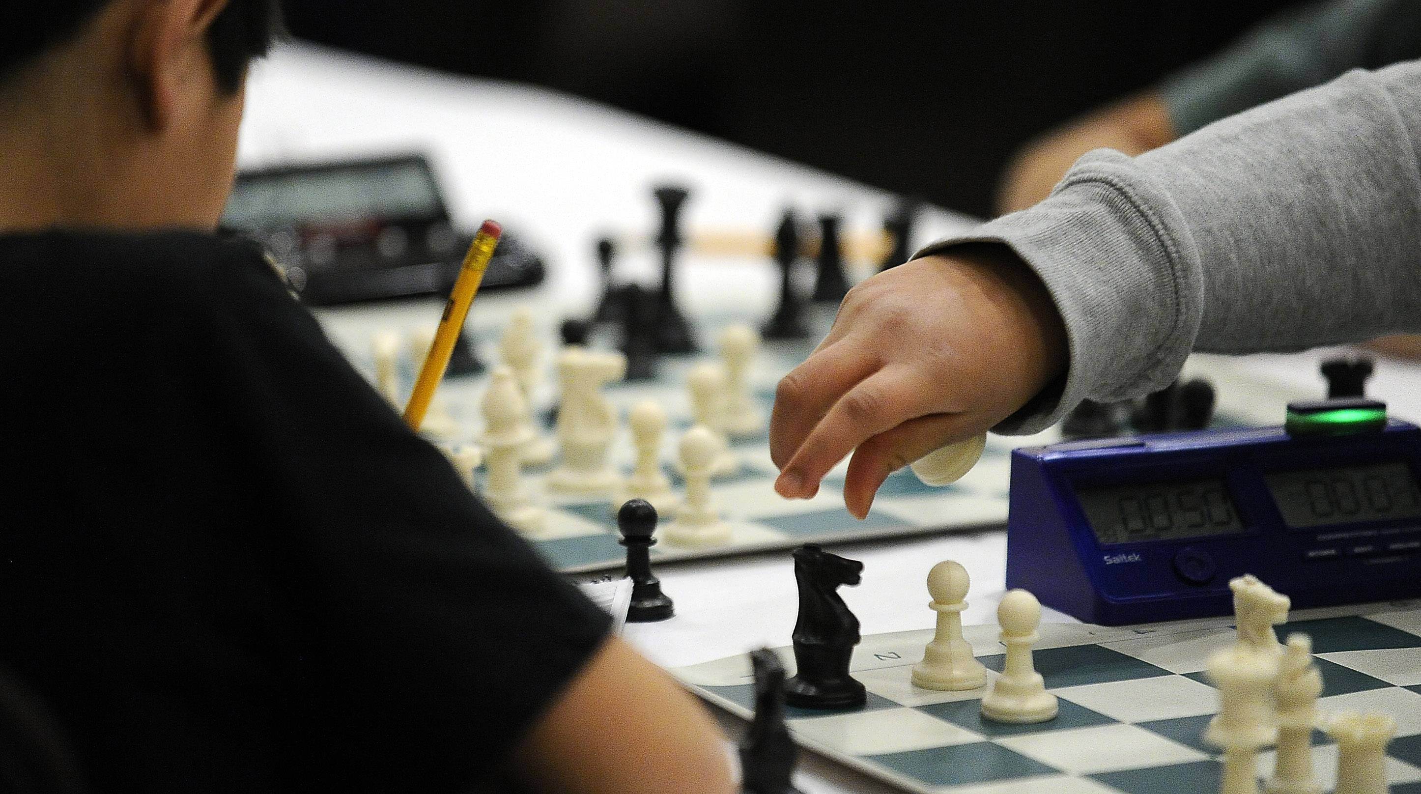 "Shreya Mangalam of South Barrington makes a ""rook takes knight"" move against Matthew Li at the Illinois K-8 Chess Championships in Schaumburg last month. Shreya, ranked the third-best girl in her age group in the U.S., won the tournament."