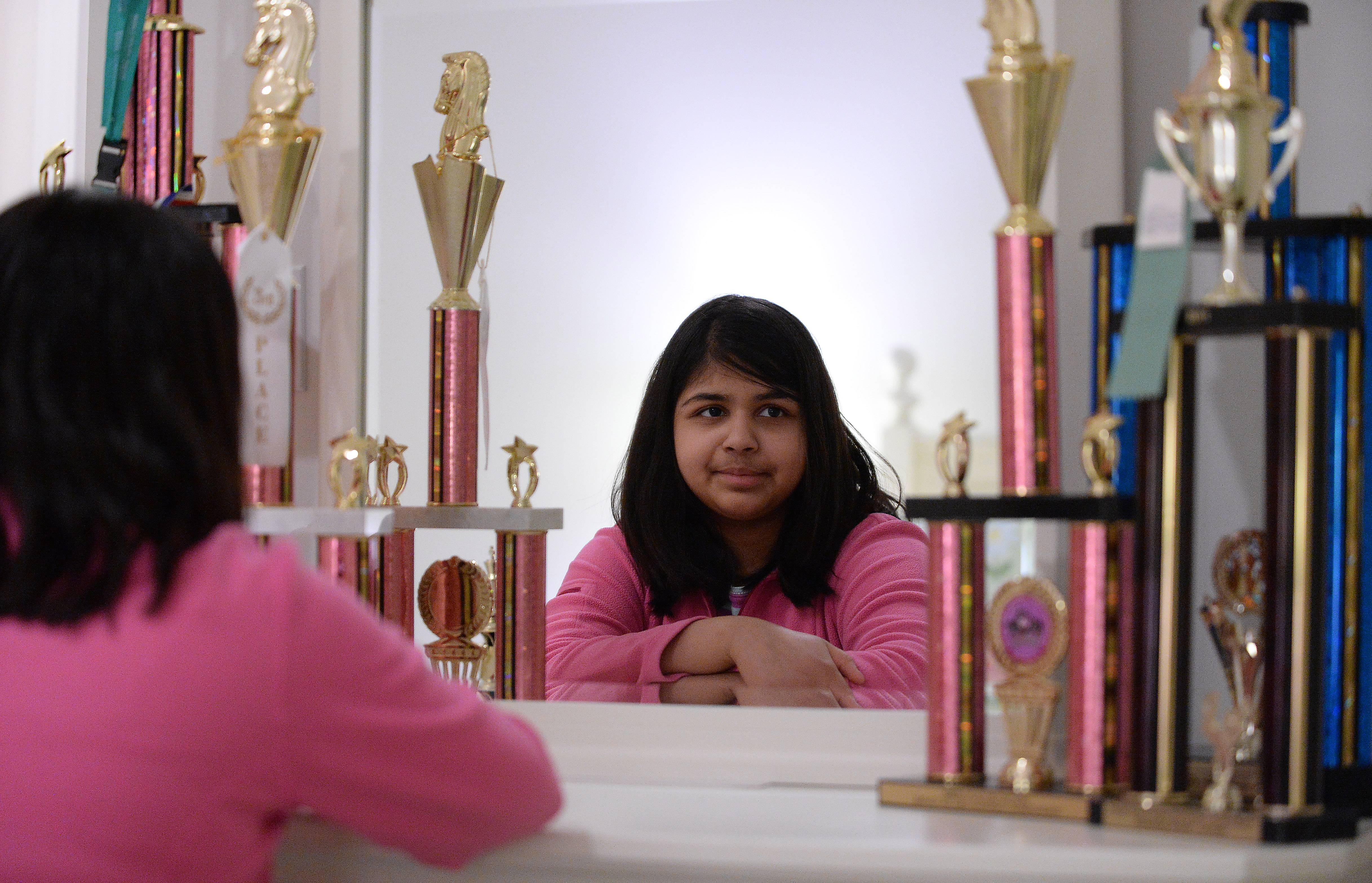 Shreya Mangalam is surrounded by chess trophies in the bedroom of her South Barrington home. Shreya is the top-rated female chess player under 16 in Illinois, and the third-rated girl under-10 in the entire country.