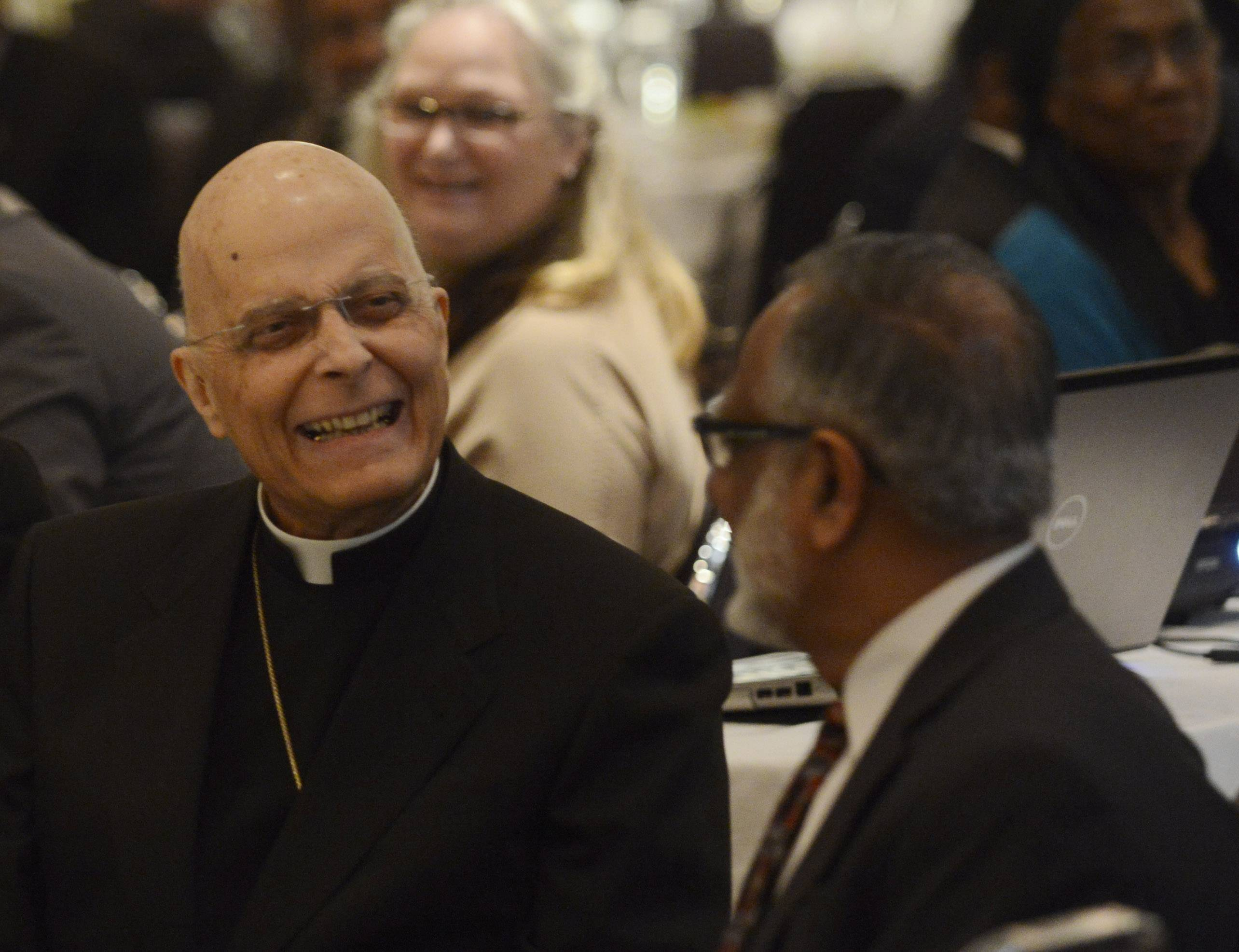 Cardinal Francis George, left, seated with Mohammed Kaiseruddin, was honored Wednesday by the Council of Islamic Organizations of Greater Chicago at Rosewood Banquets in Rosemont.