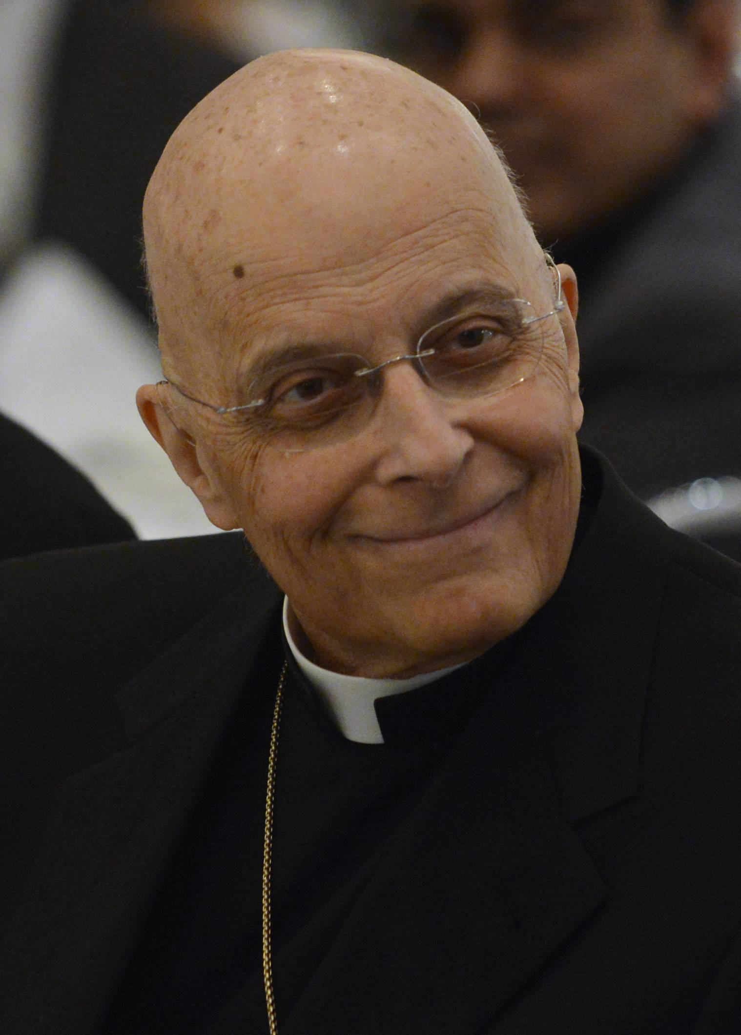 Cardinal Francis George listens to a speaker at the Council of Islamic Organizations of Greater Chicago's reception in his honor Wednesday at Rosewood Banquets in Rosemont.