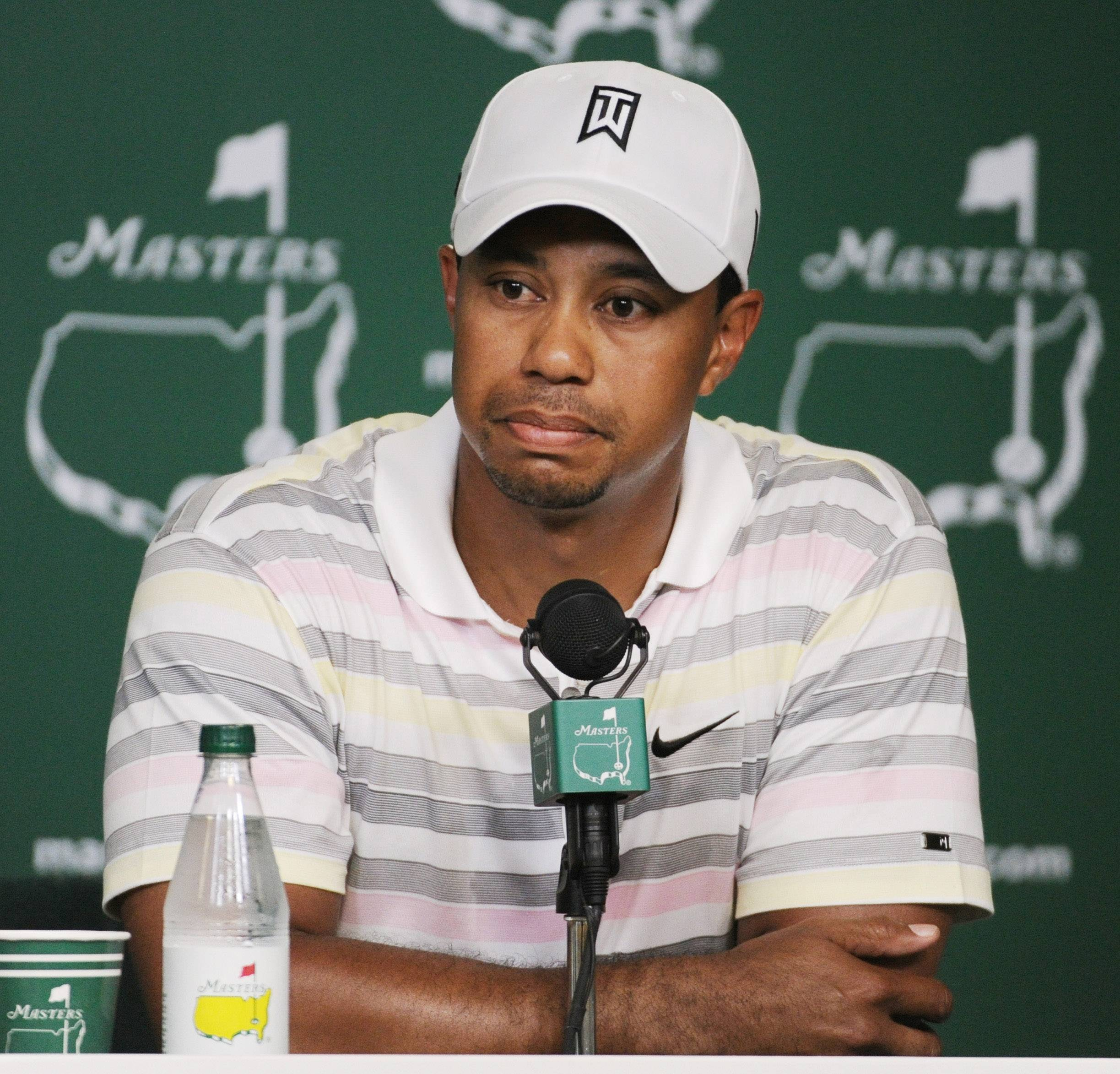 Tiger Woods listens to a question during his news conference at the 2010 Masters golf tournament in Augusta, Ga. Woods will miss the Masters for the first time in his career after having surgery on his back.