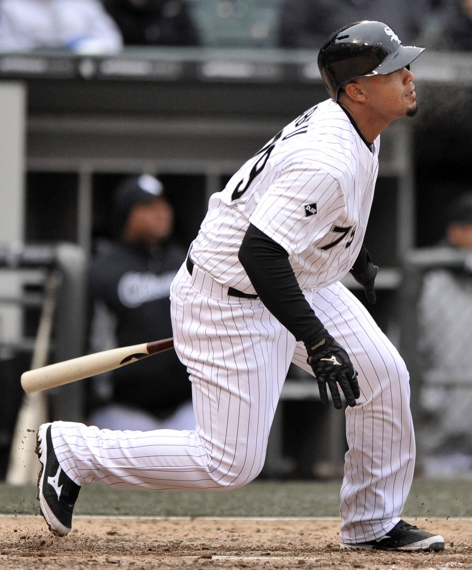 Chicago White Sox's Jose Abreu watches his three-run triple during the sixth inning of a baseball game against the Minnesota Twins in Chicago, Thursday, April 3, 2014.