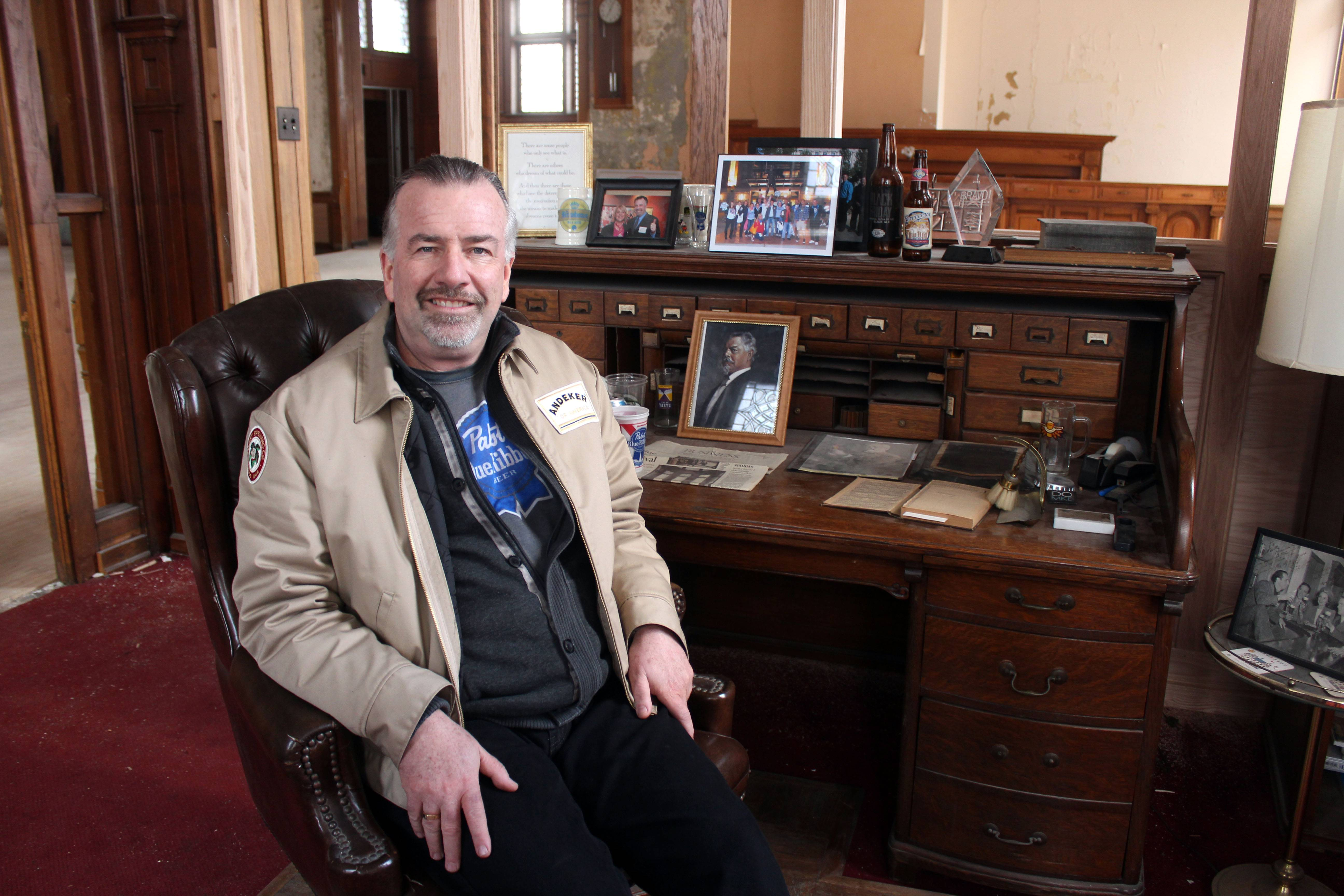 Jim Haertel sits at the desk of Frederick Pabst, who started the Pabst Brewery in 1884, in Milwaukee. He bought the company's former administrative building and another one in 2001. He supports an effort to try to raise money to bring the company's headquarters back to Milwaukee.