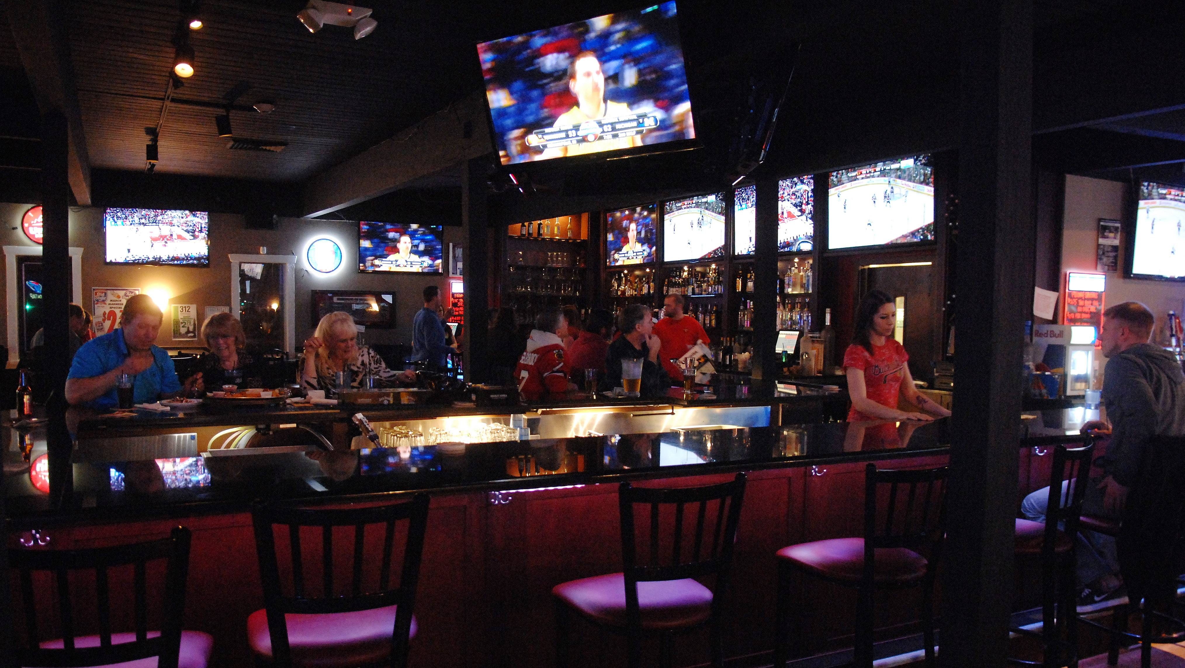 You can watch a game upstairs at D Hangout Bar and Grill in Elgin, or mellow out in a separate piano bar.