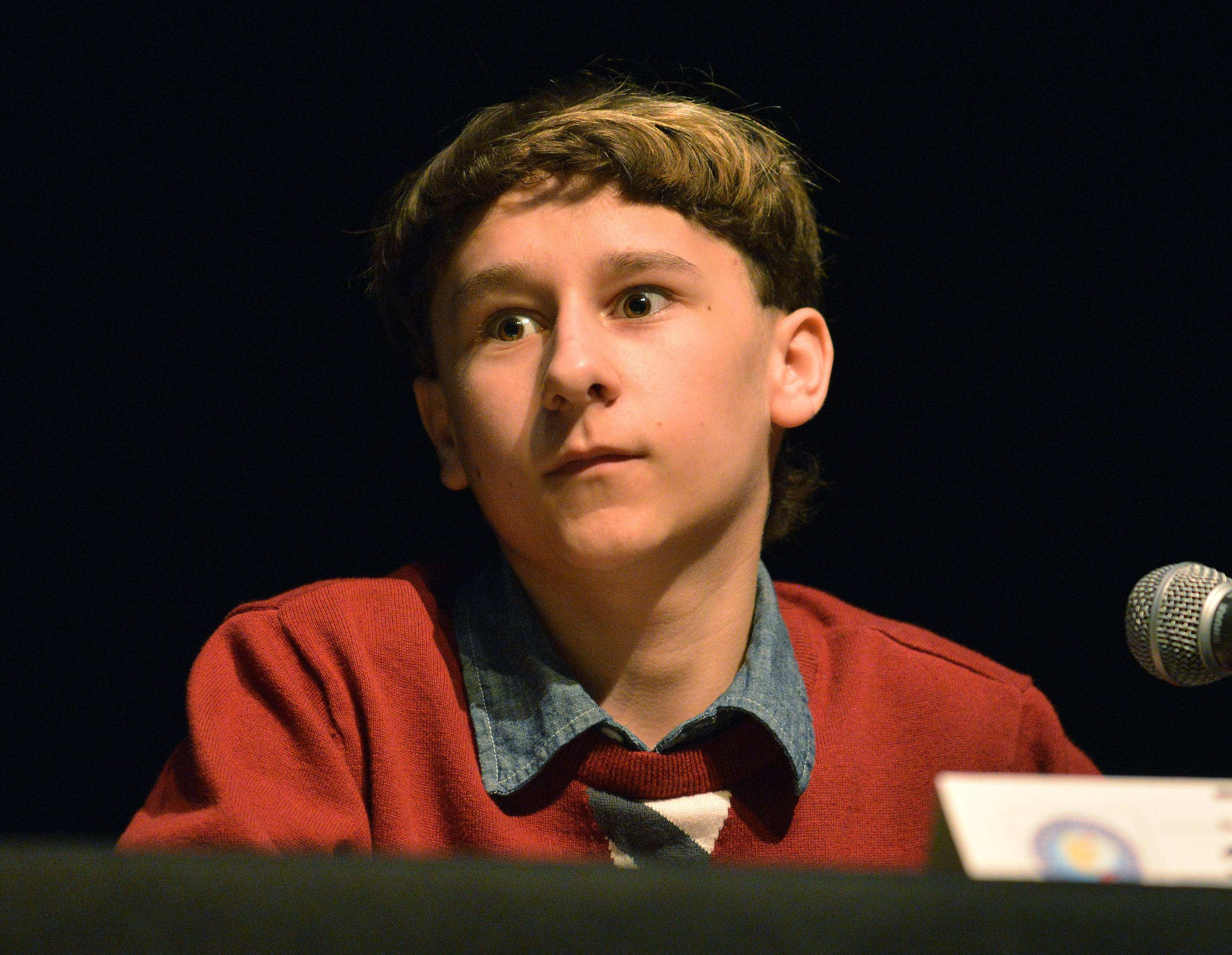 Joshua Smoron of Gurnee realizes he's just taken second place in the championship round of the state competition of the National Geographic Bee, held Friday at the College of DuPage in Glen Ellyn.