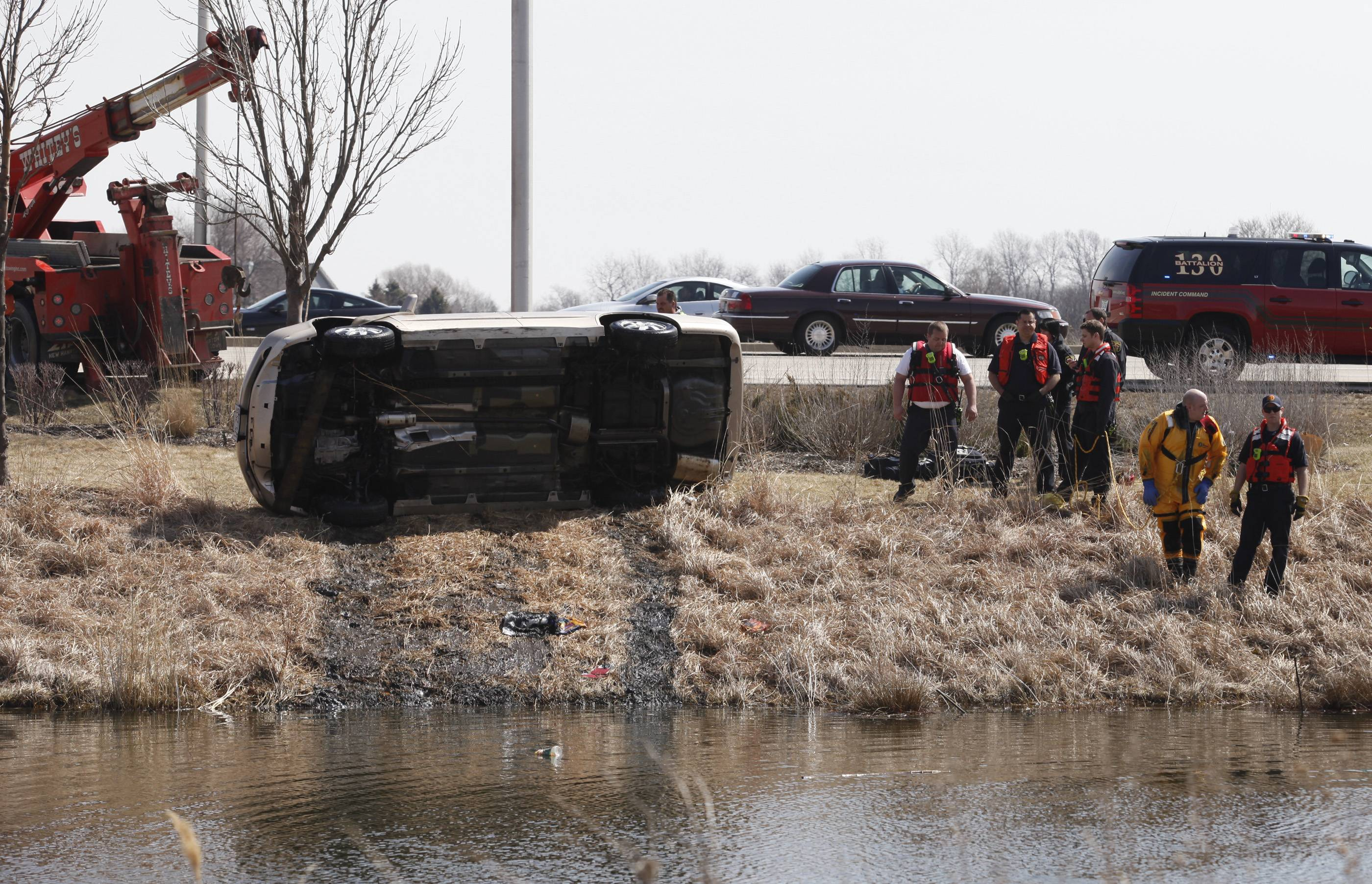 The car that crashed into a pond near Algonquin Commons is pulled from the water Wednesday afternoon after first responders smashed the vehicle's sunroof and pulled the driver from the sinking car. The driver was unconscious and not breathing when he was pulled from the car.