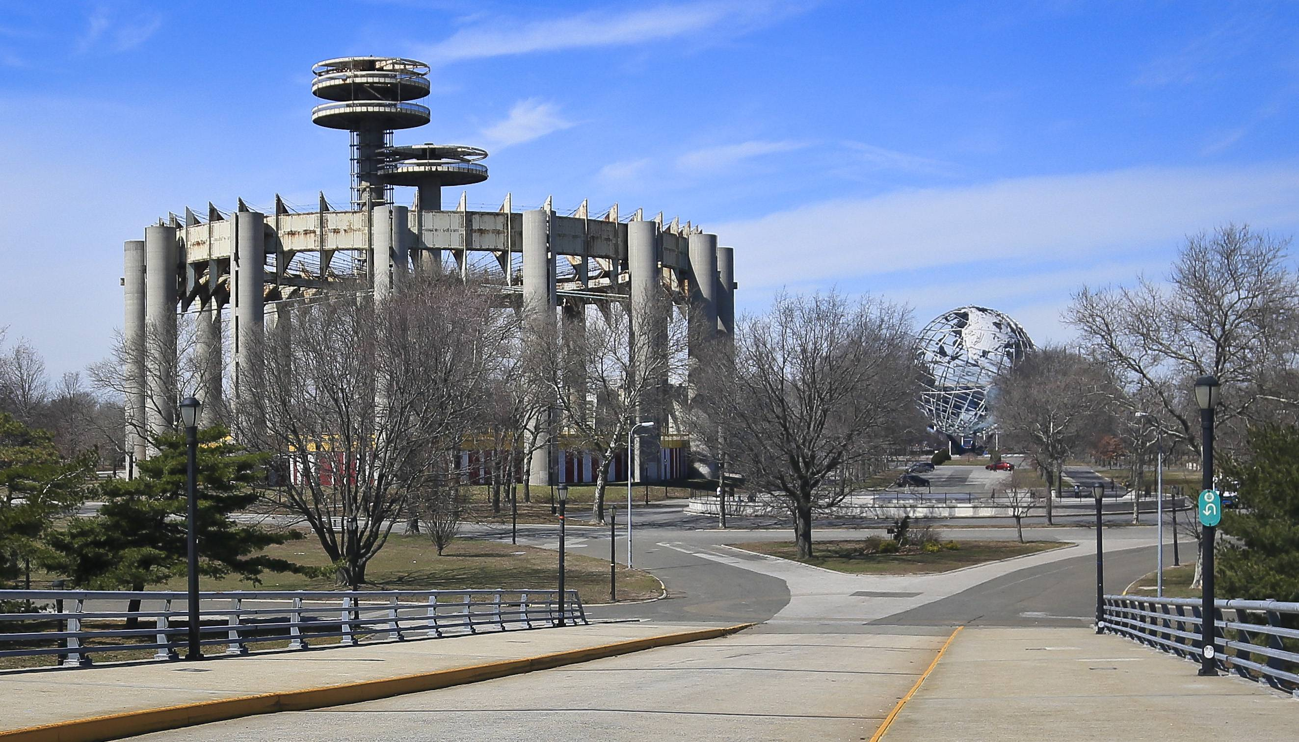 A space-age tower, left, and a restored giant metal globe called the Unisphere, remain as original structures from the 1964 World's Fair in the Queens borough of New York.