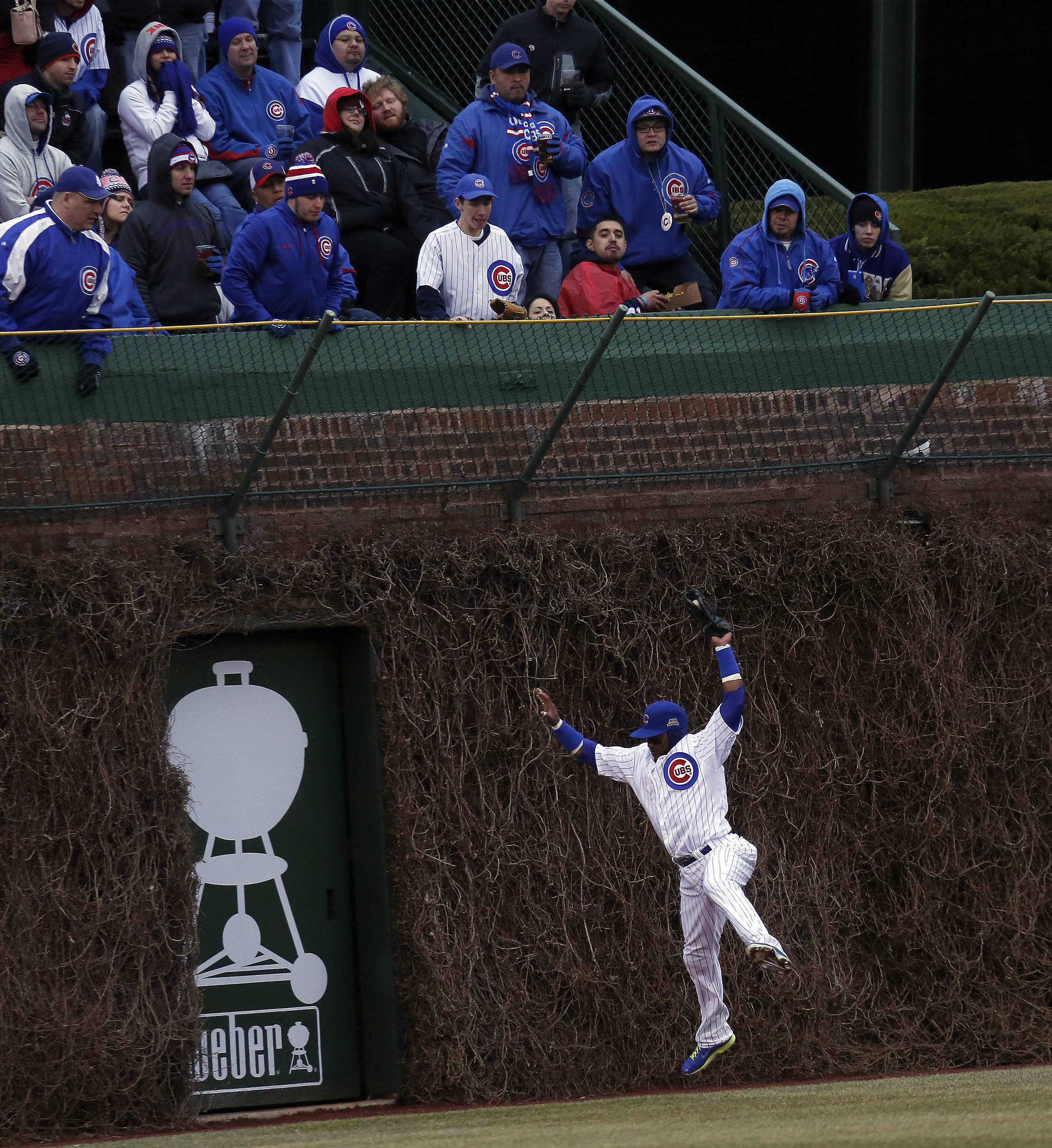 Not only is the Cubs' Emilio Bonifacio hitting up a storm, he is playing some impressive defense. Here he grabs a drive in center field off the bat of the Phillies' Ryan Howard in the seventh inning Friday at Wrigley Field.