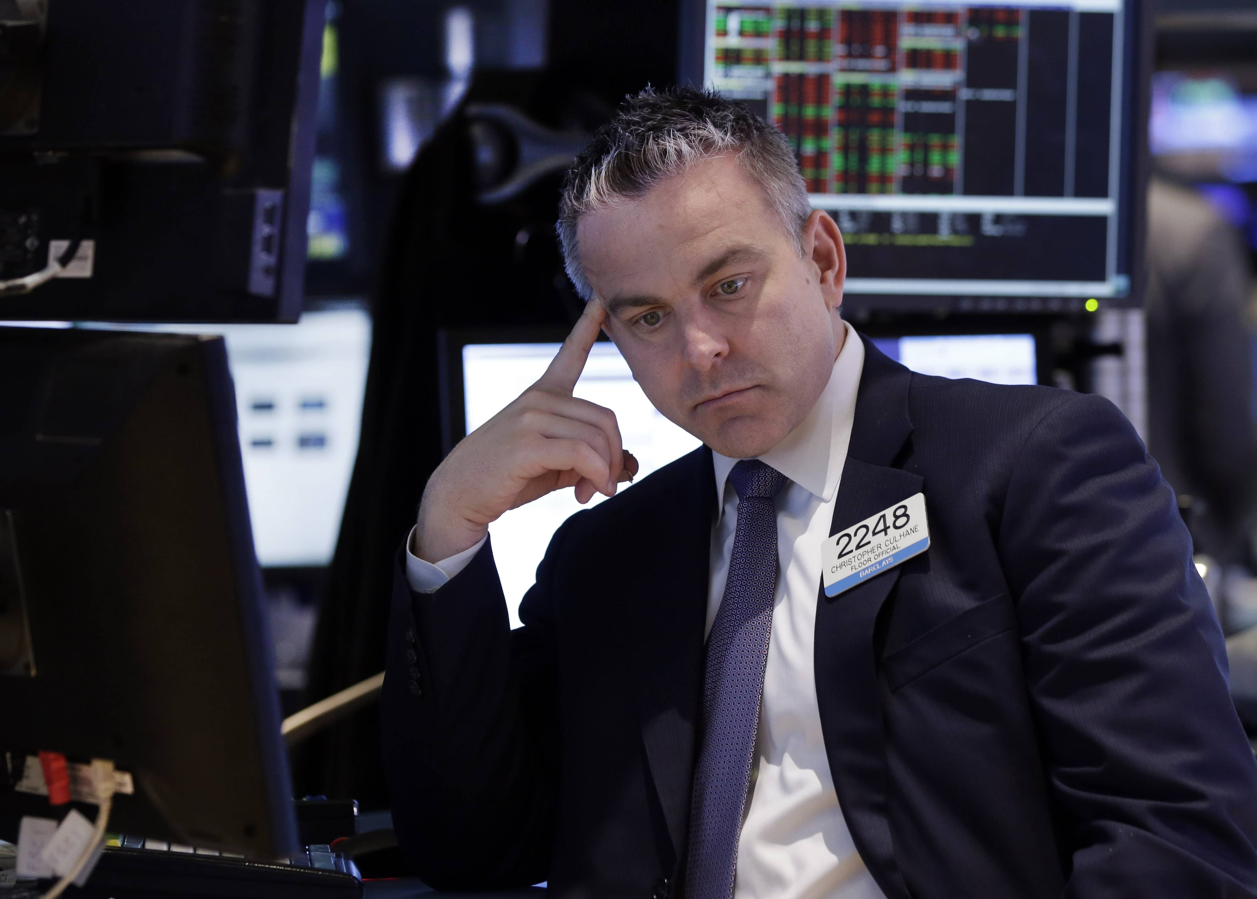 Specialist Christopher Culhane works on the floor of the New York Stock Exchange, Friday, April 4, 2014.  Technology stocks fell sharply in afternoon trading Friday, bringing the broader market lower. Mixed signals in the government's monthly jobs report left investors with little reason to cheer.
