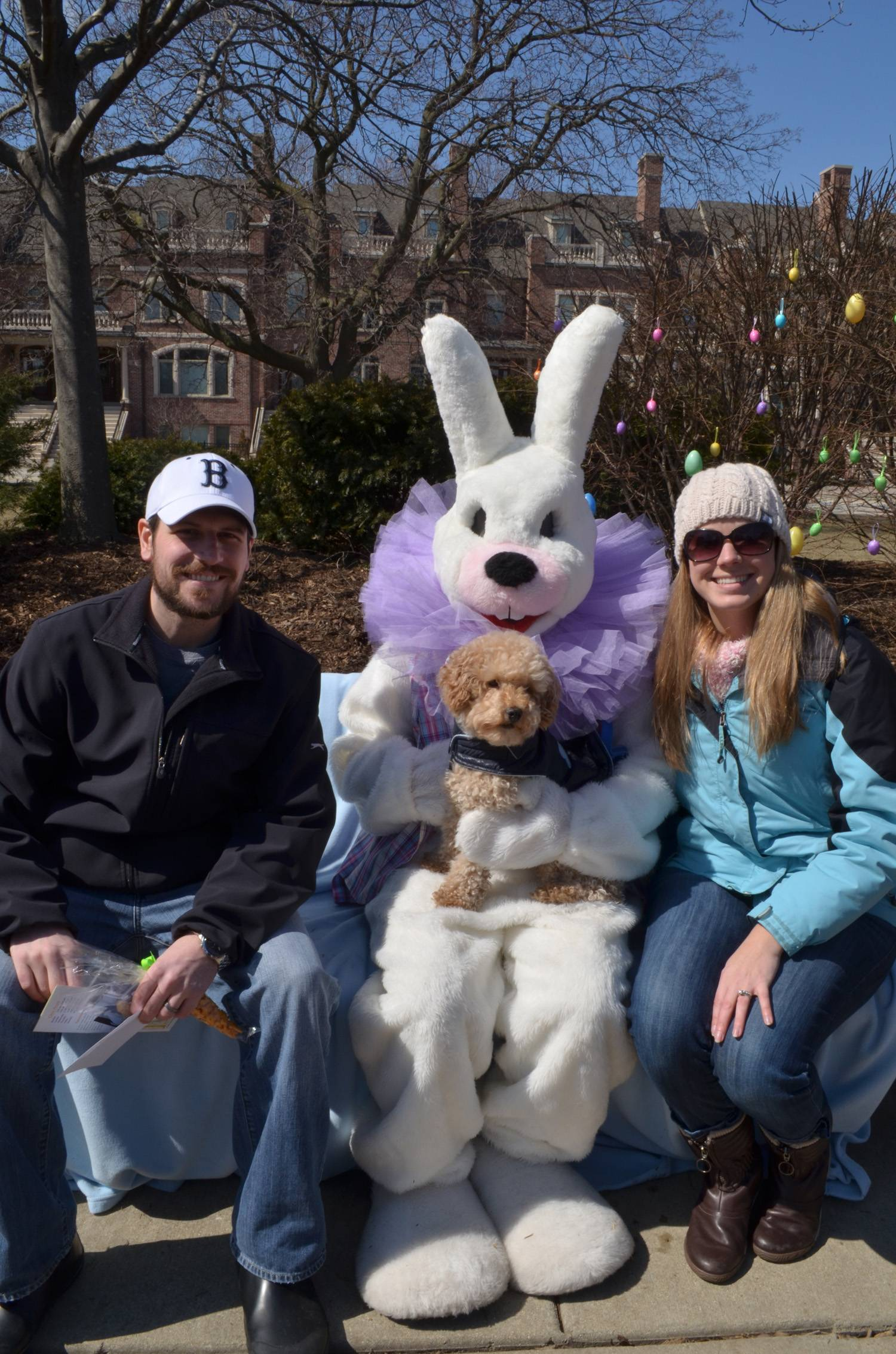 Dogs and their owners receive a souvenir photo at Palatine Park District's Hound Egg Hunt.