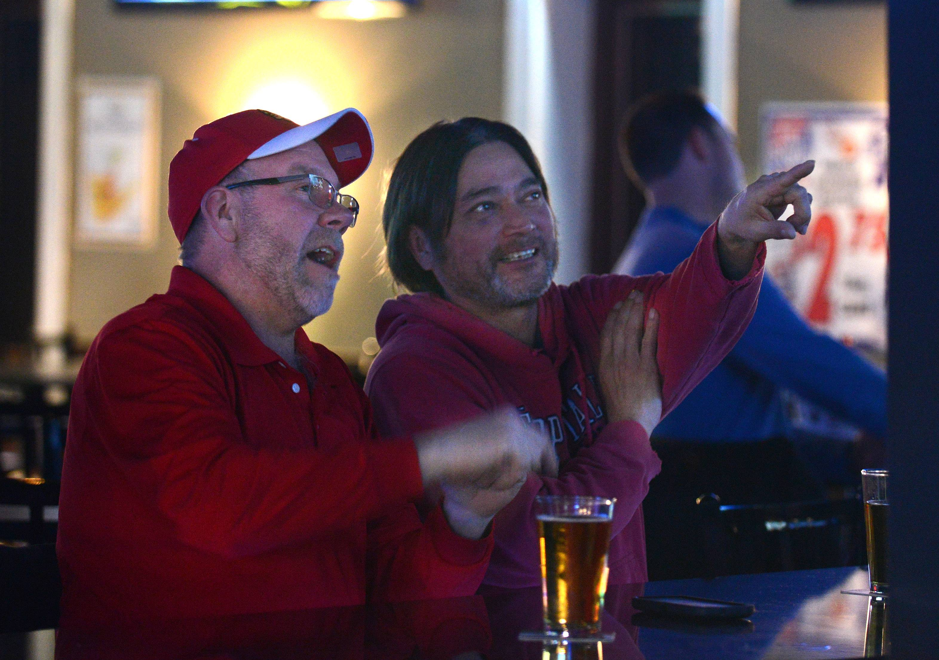 Scott Baker, left, and Rupert Siete, both of Elgin, watch the Blackhawks at D Hangout Bar and Grill in Elgin.