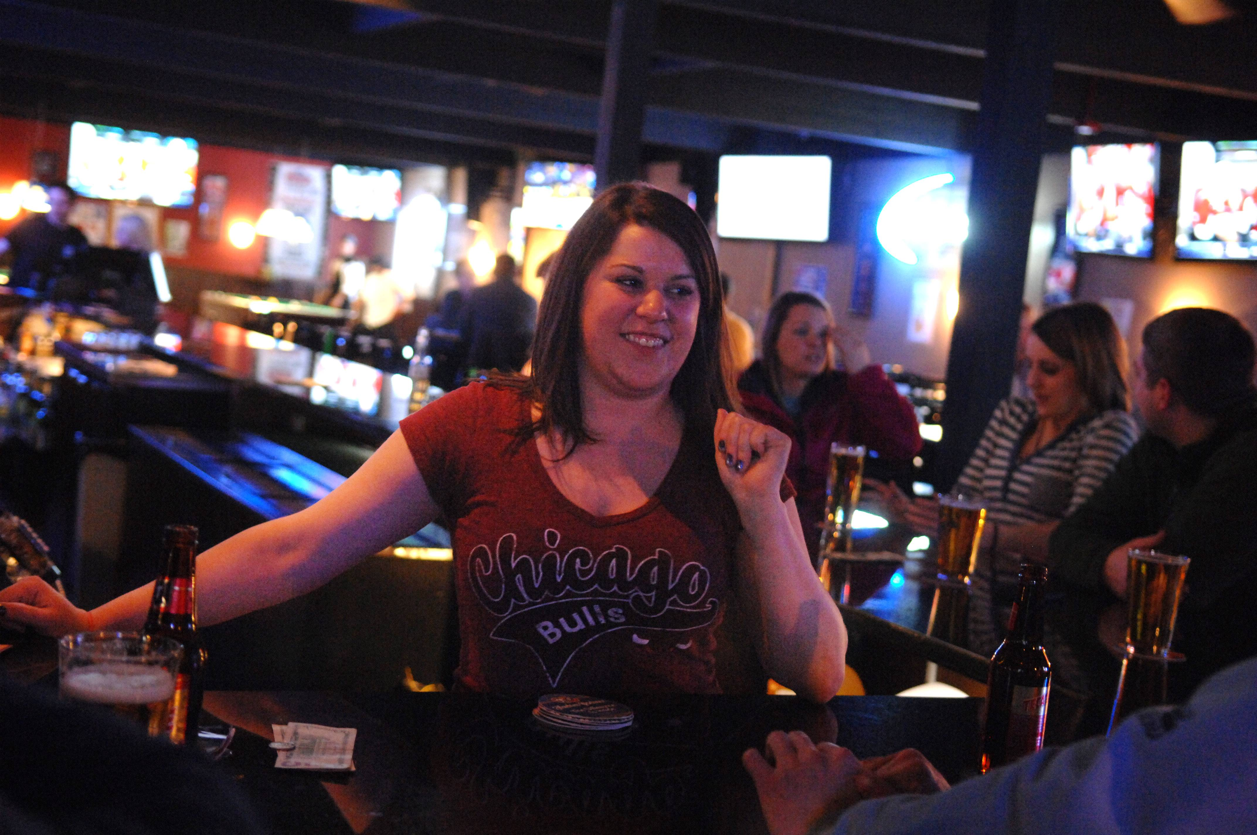Bartender Annie Myers chats with customers at D Hangout Bar and Grill in Elgin.