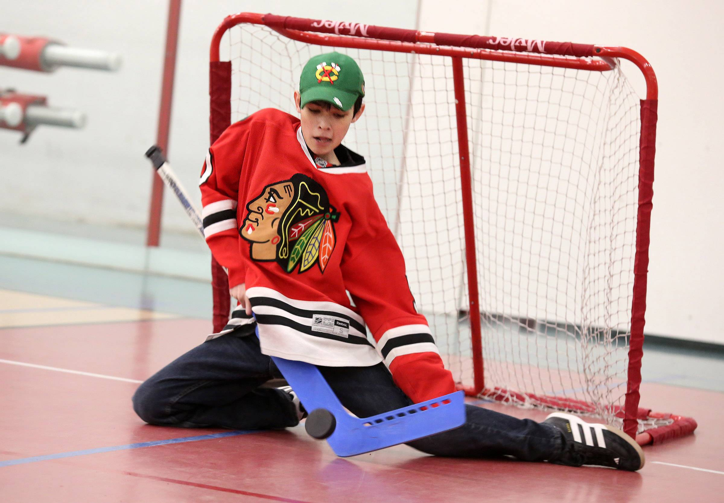 Ethan Neir, 13, of Libertyville, blocks a shot on goal during the Chicago Blackhawks Roadwatch Party on Friday at the Libertyville Sports Complex.
