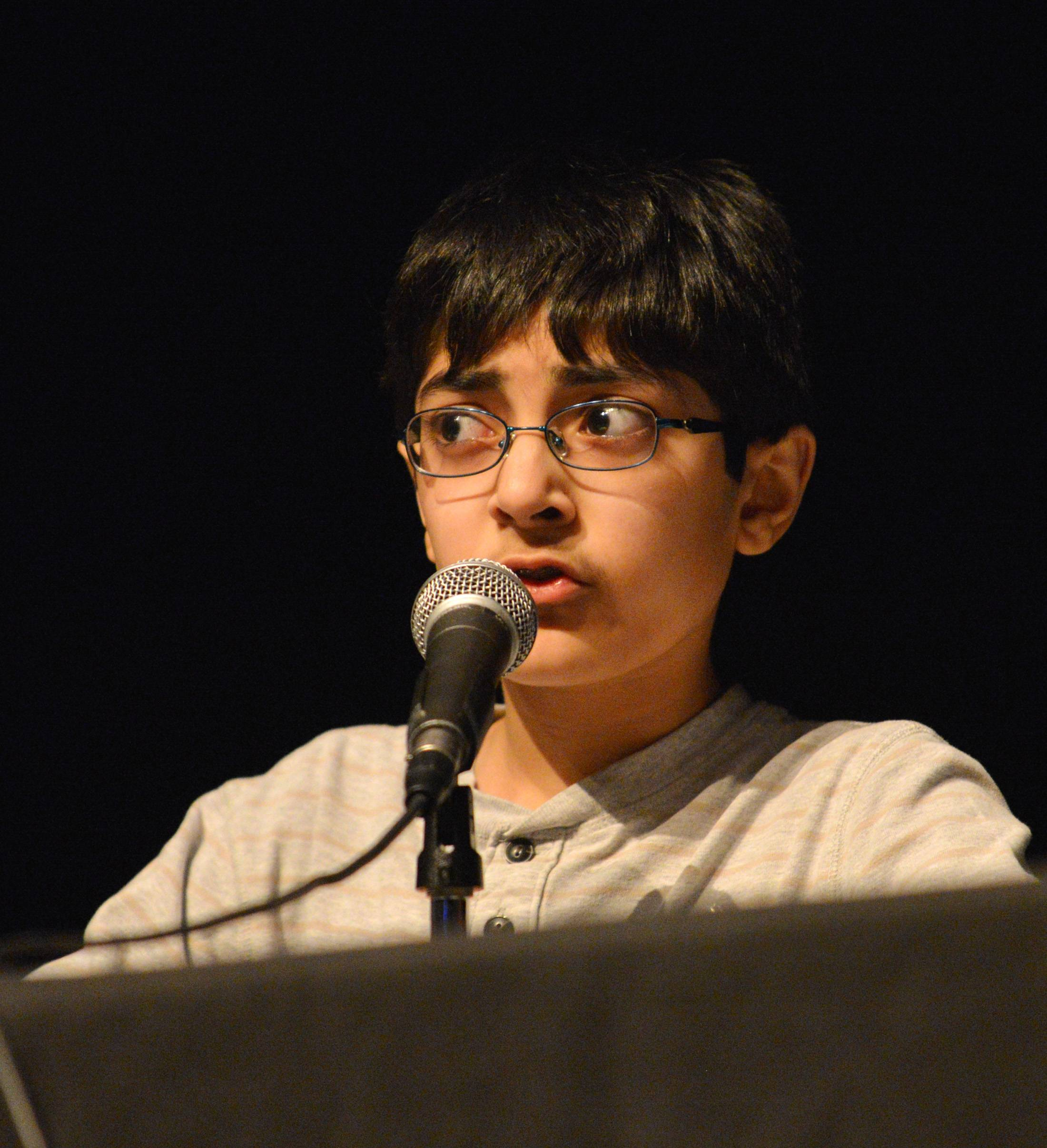 Aditya Badlani of Oak Brook, who finished in third place, answers a question in the final round of state-level competition of the National Geographic Bee in Glen Ellyn.