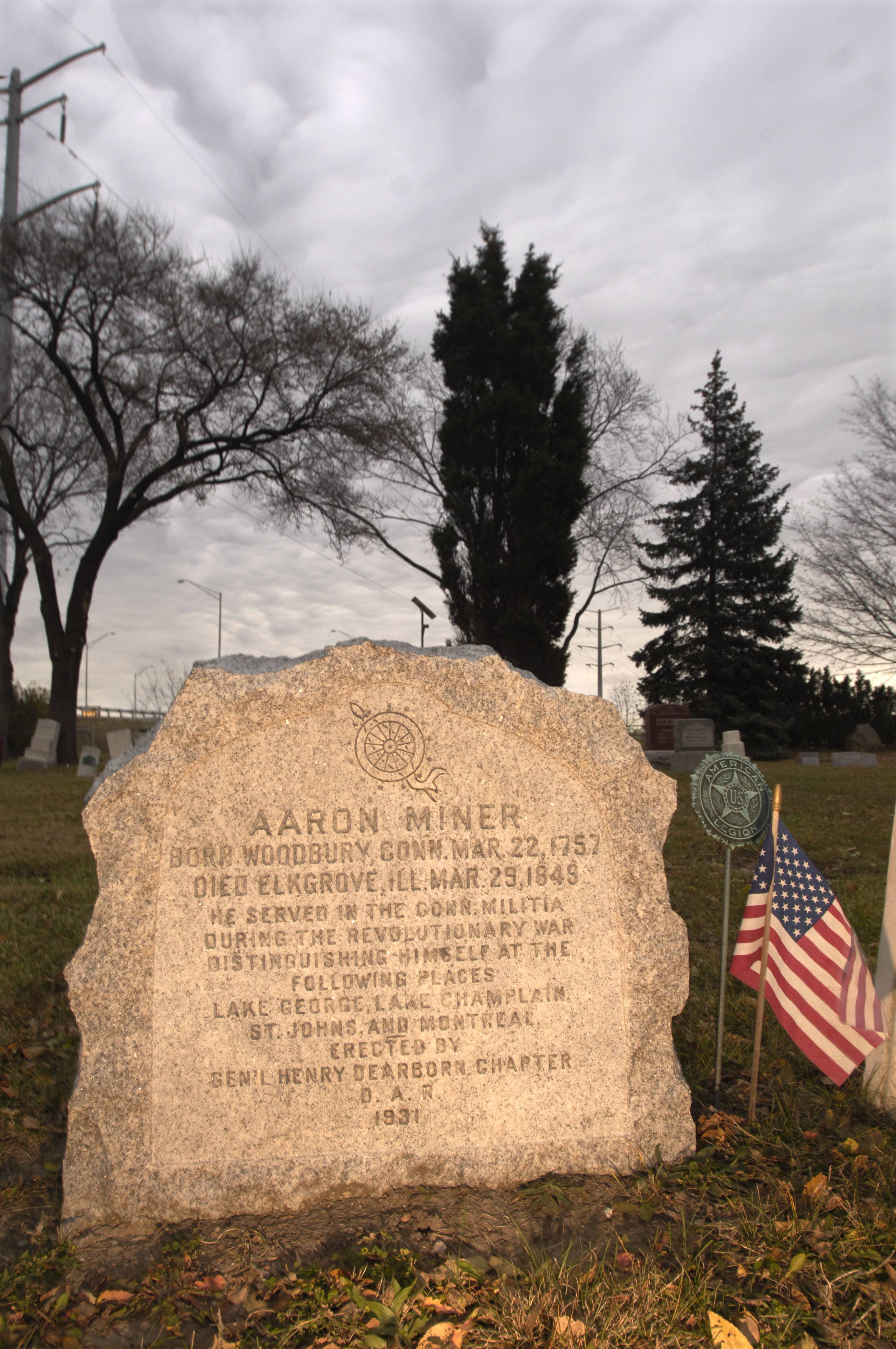 A gravestone at Elk Grove Cemetery recognizes Revolutionary War veteran Aaron Miner. The Illinois Sons of the American Revolution plan to install a historical marker at the cemetery to recognize Miner and another Revolutionary War figure, Eli Skinner, who is also buried there.