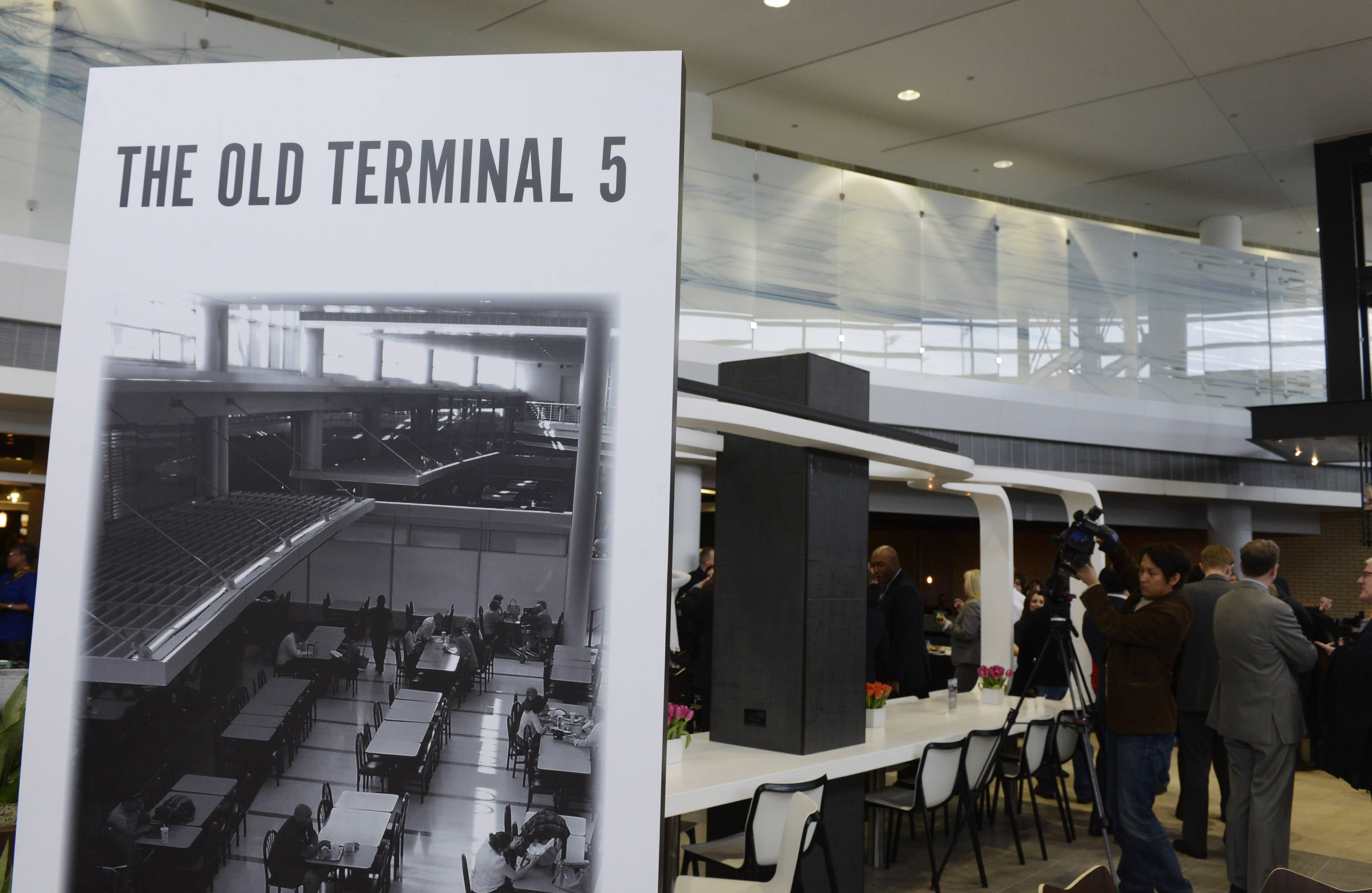Posters provide a before-and-after view of the renovated International Terminal 5 at O'Hare International Airport unveiled Friday.