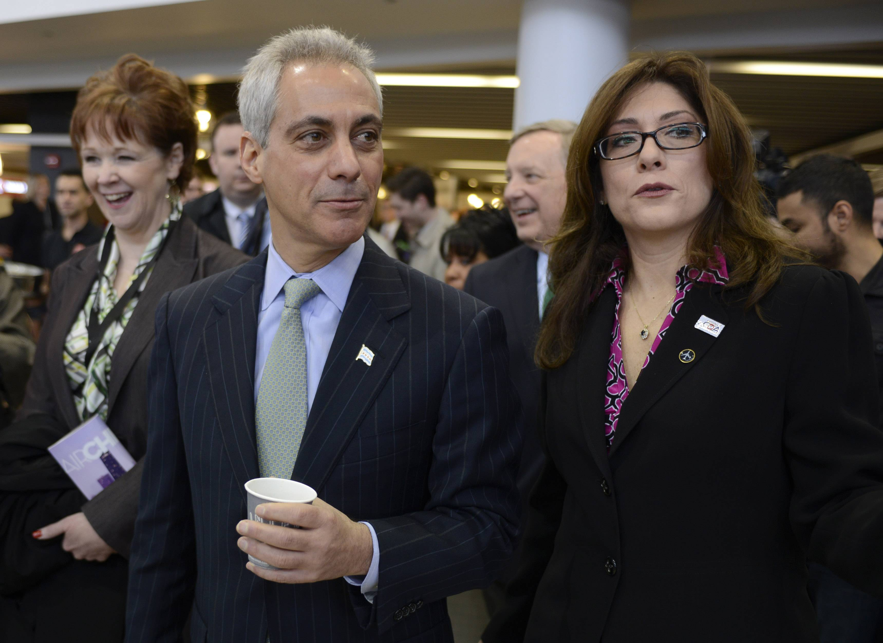 Chicago Department of Aviation Commissioner Rosemarie Andolino leads Chicago Mayor Rahm Emanuel on a tour as the renovated International Terminal 5 is unveiled at O'Hare International Airport Friday.