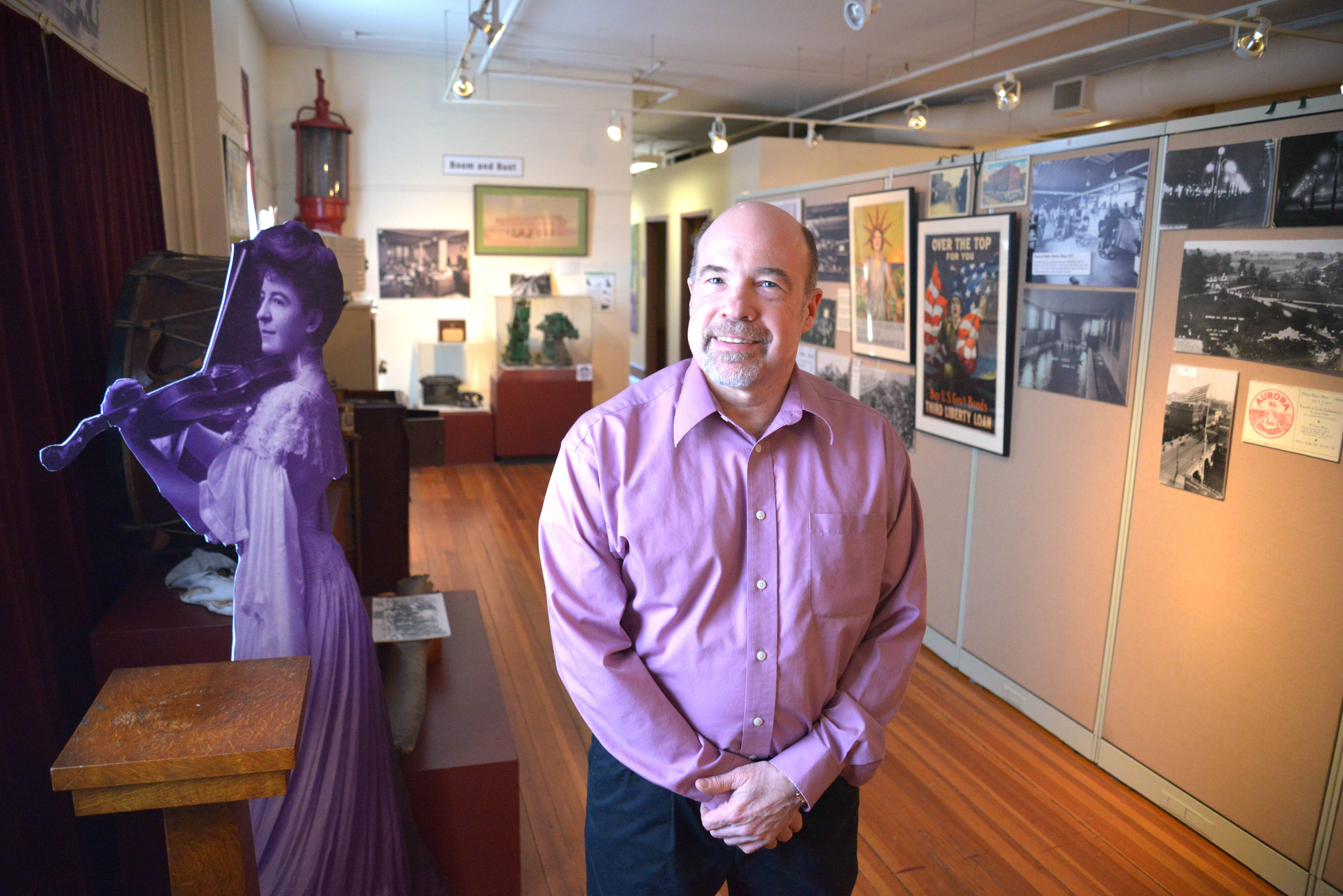 John Jaros stands in the Aurora Story exhibit, his favorite at the museum.
