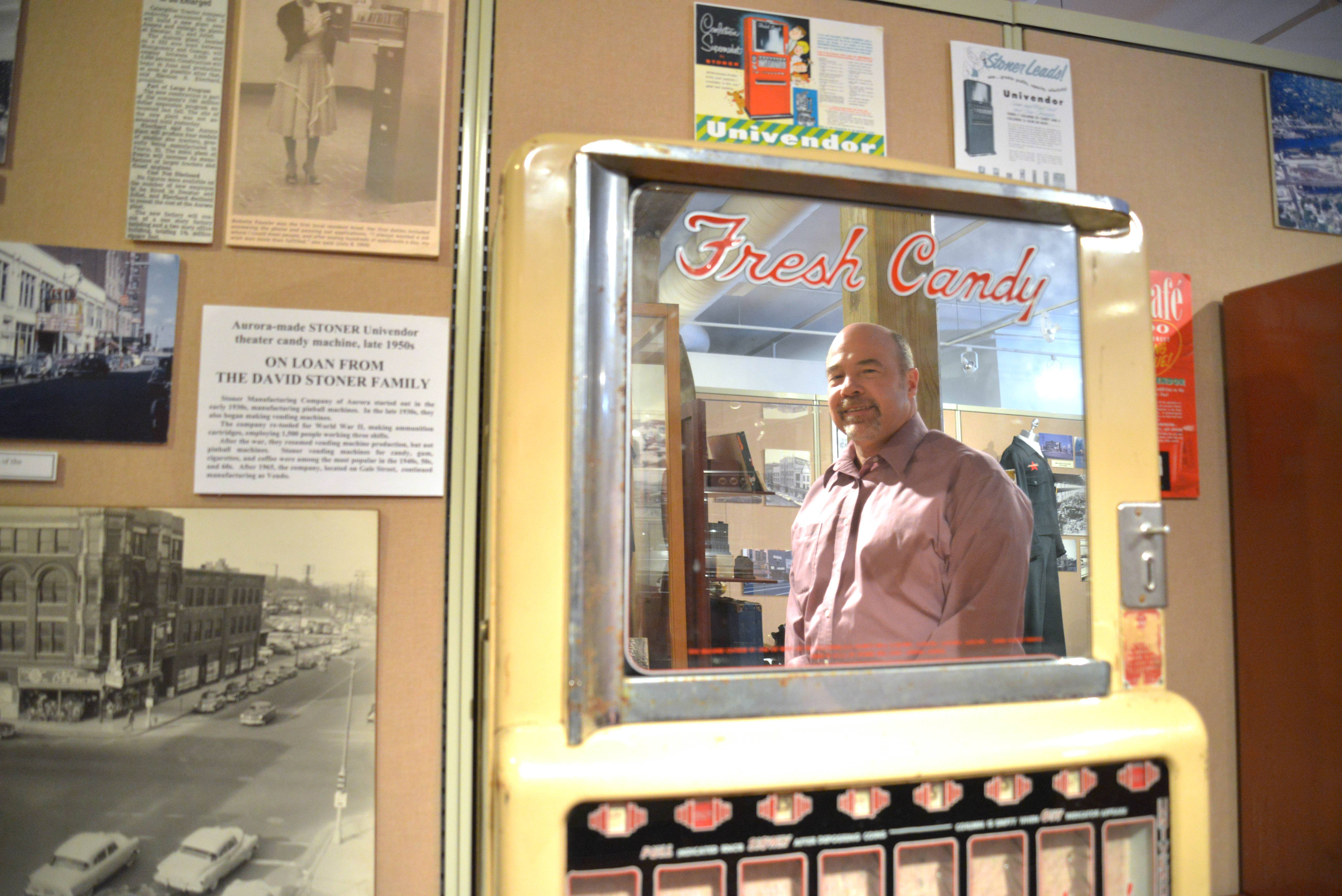 Jaros' reflection is captured in an old candy machine that is on display at the historical society.
