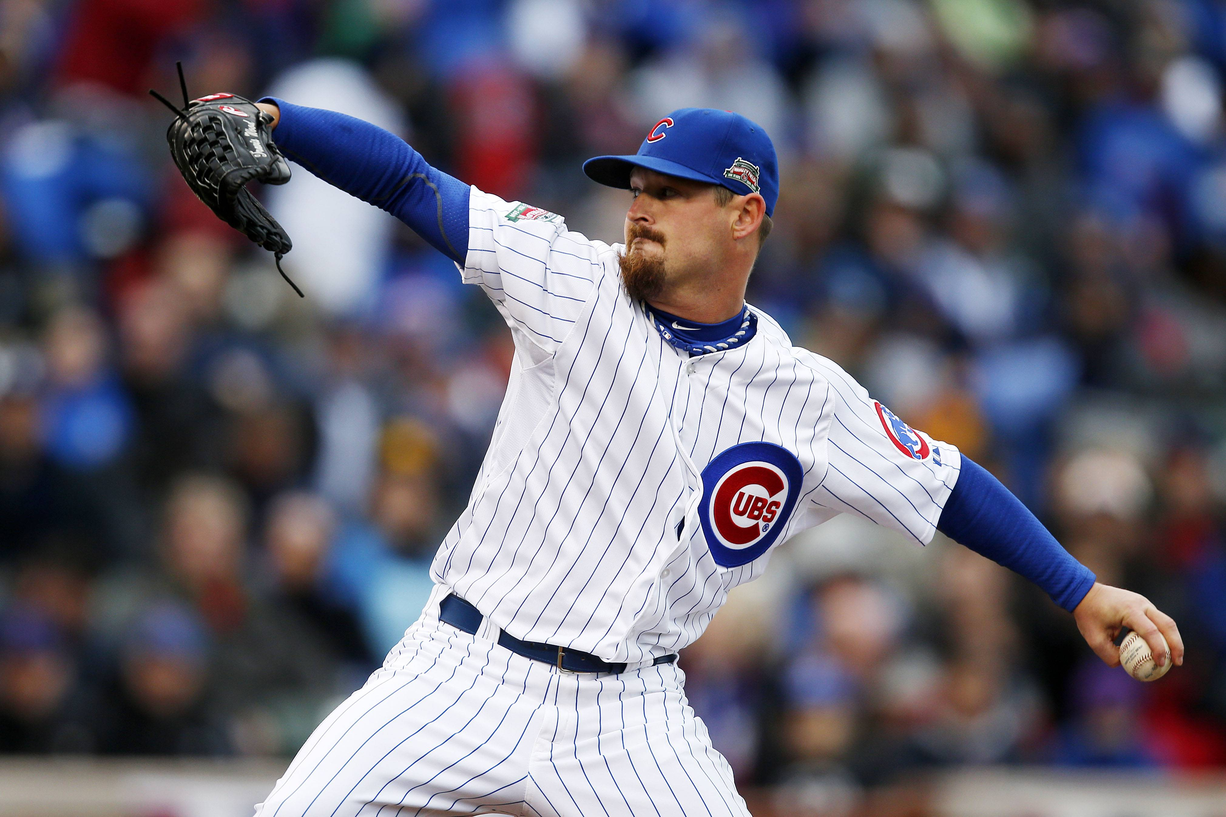 Chicago Cubs starting pitcher Travis Wood pitches against the Philadelphia Phillies during the first inning of the team's home opener Friday.