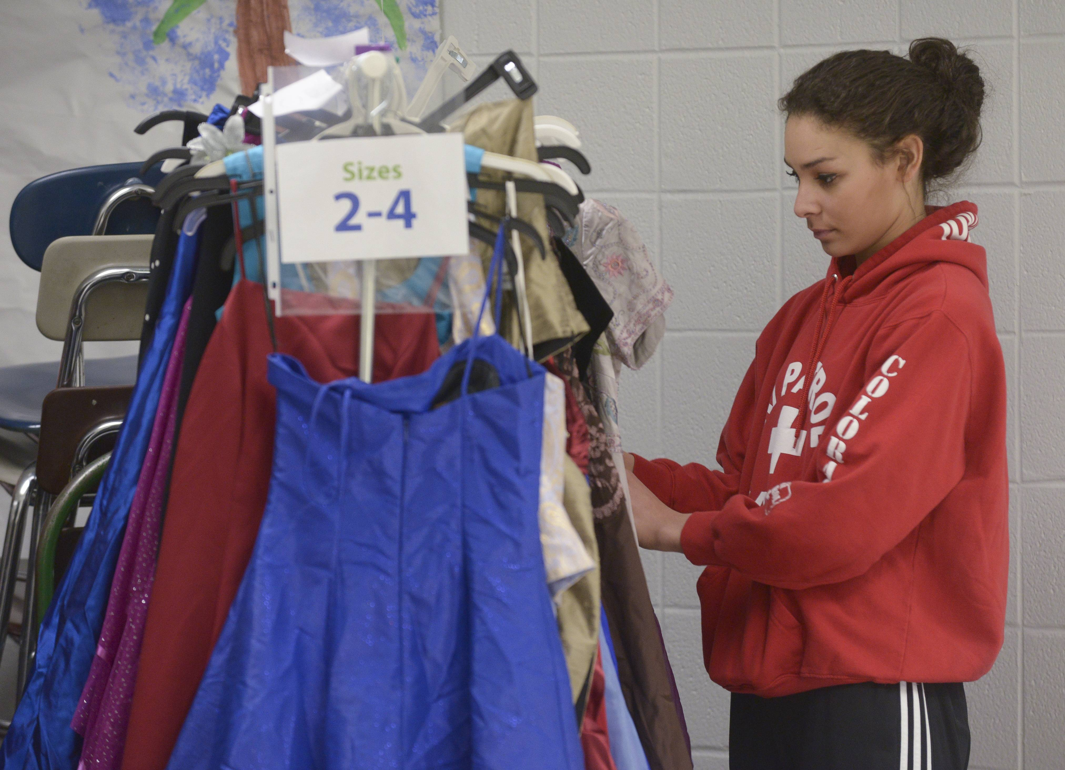 "Hellen Campbell, 17 of Oswego High Schools stars her search for prom dress she likes during the ""Prom Goes Green"" event sponsored by USagain at West Chicago Community High School. The event allows girls to get free prom dresses to offset the high cost of going to prom."