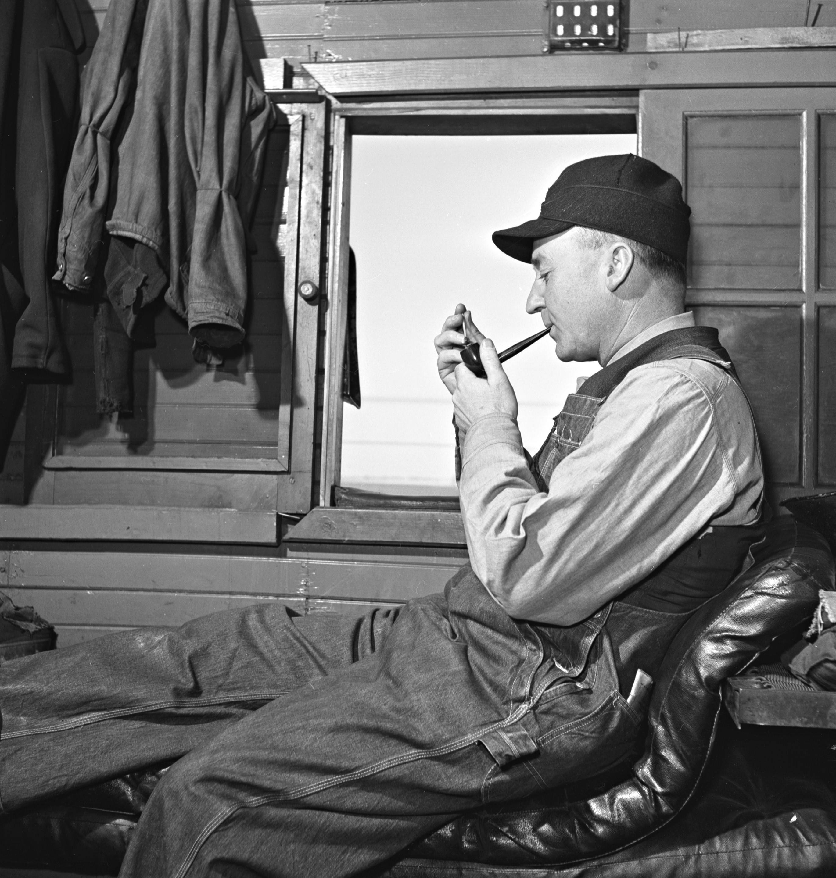 In this 1943 photograph by Jack Delano, Clarence Dwight Averill takes a break from his job as a freight train conductor. The West Chicago man spent nearly 50 years working for the Chicago & Northwestern Railway.