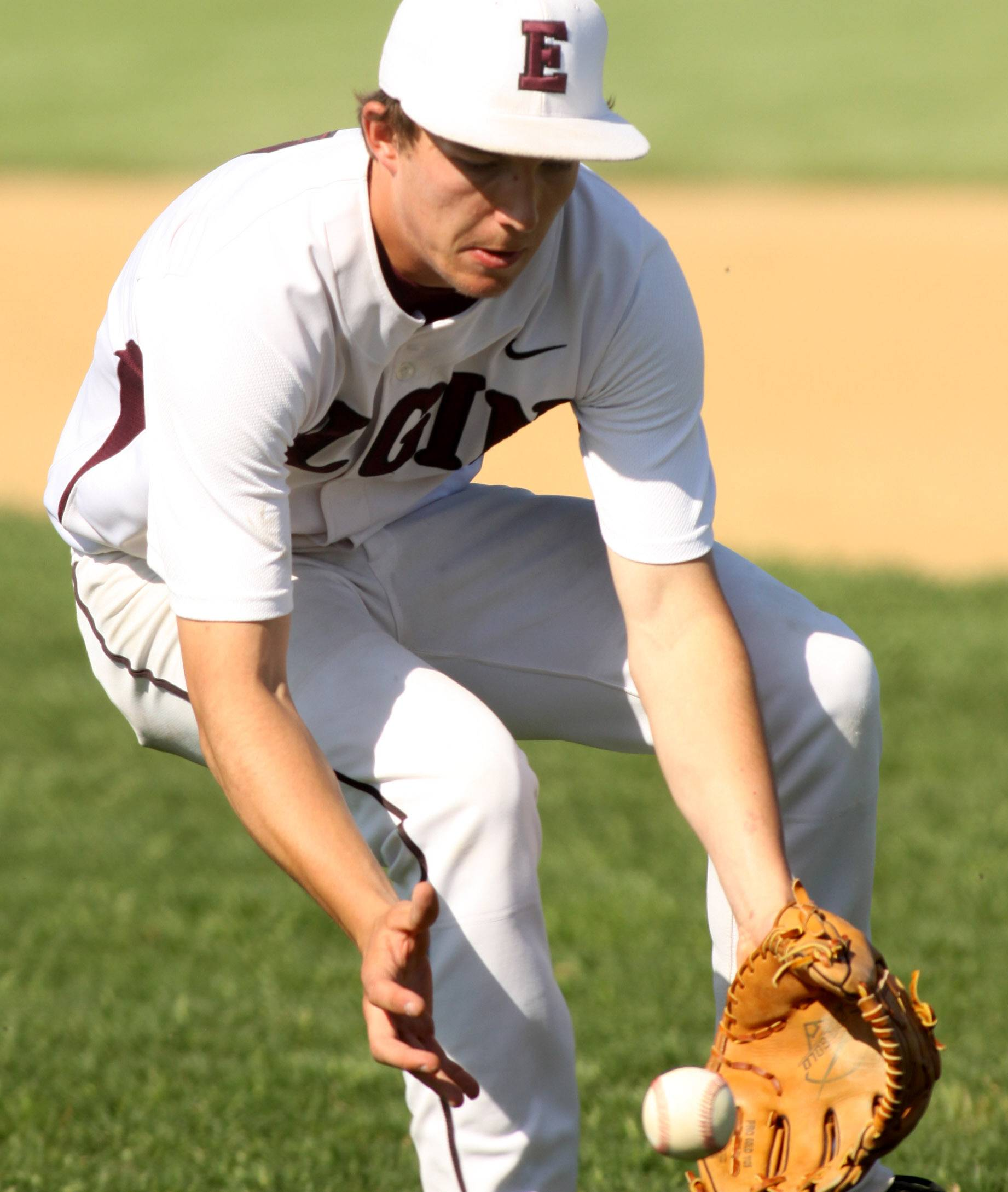 Elgin's Ryan Sitter fields a grounder before firing to first for an out against Hoffman Estates last season. The Maroons are scheduled to host St. Edward at 11 a.m. Saturday.