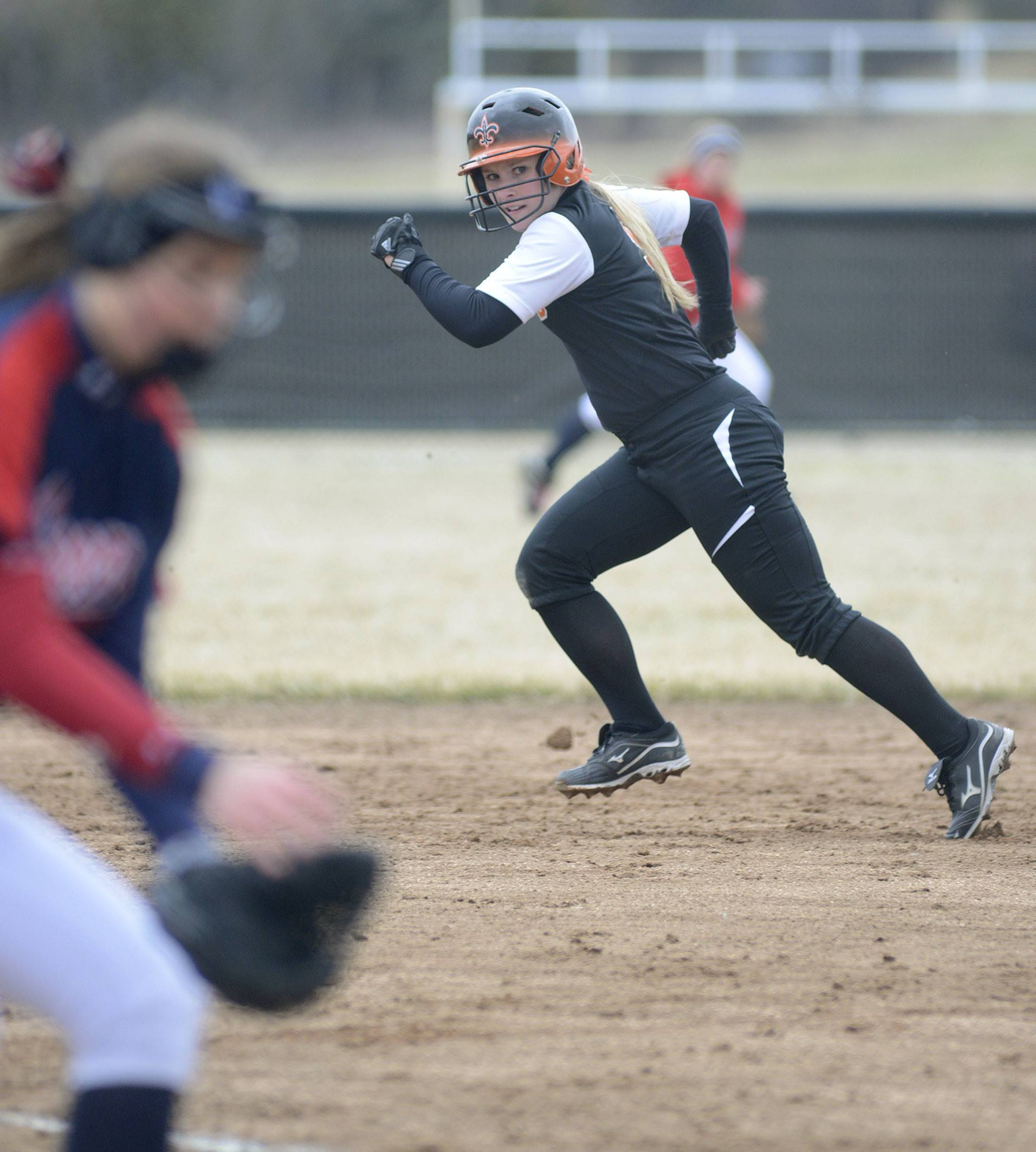 St. Charles East's Sarah Collalti heads to second base as West Aurora's Kaylee Hayton pitches in the third inning on Friday, April 4.