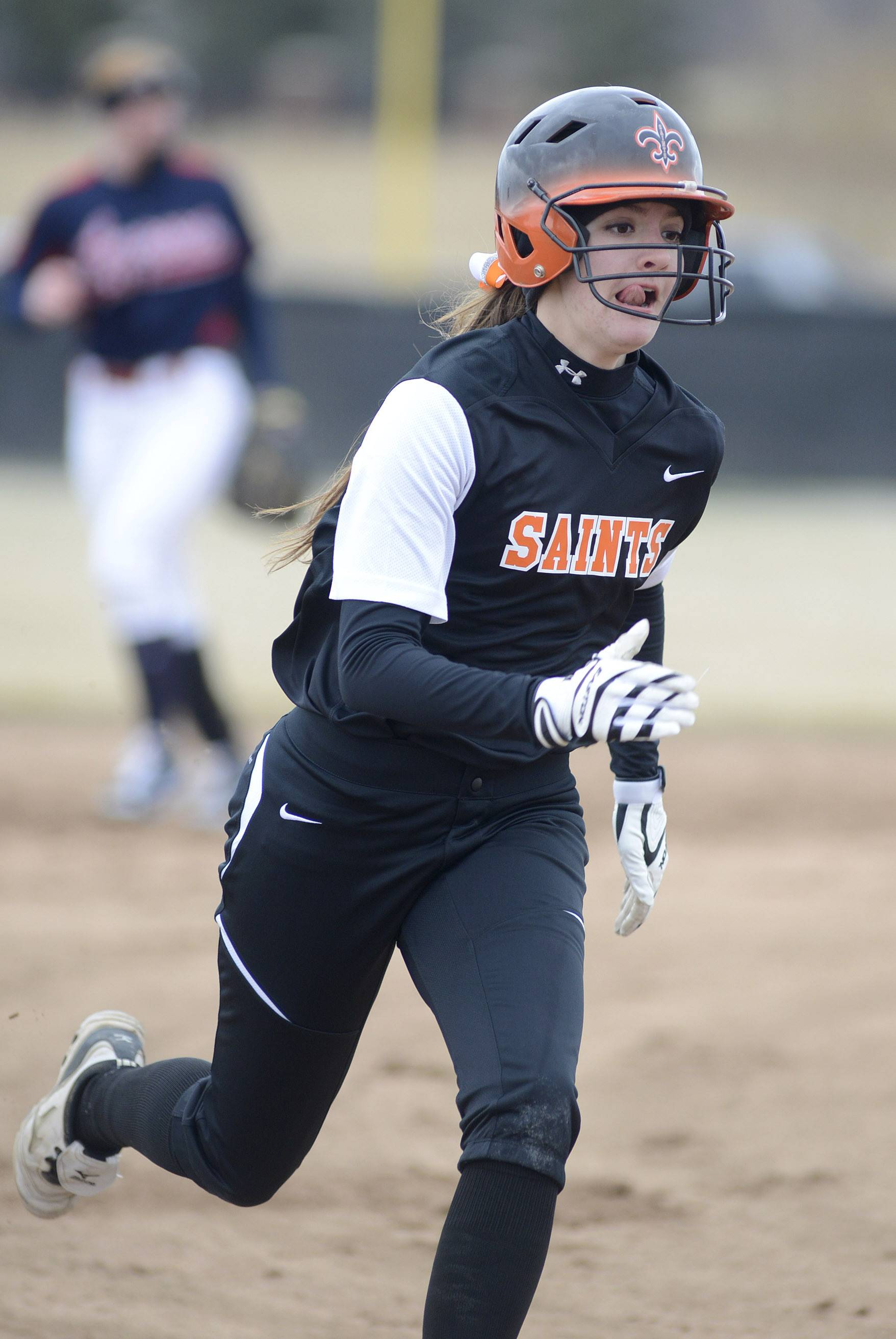 St. Charles East's Tess Hupe heads to third base in the first inning on Friday, April 4.