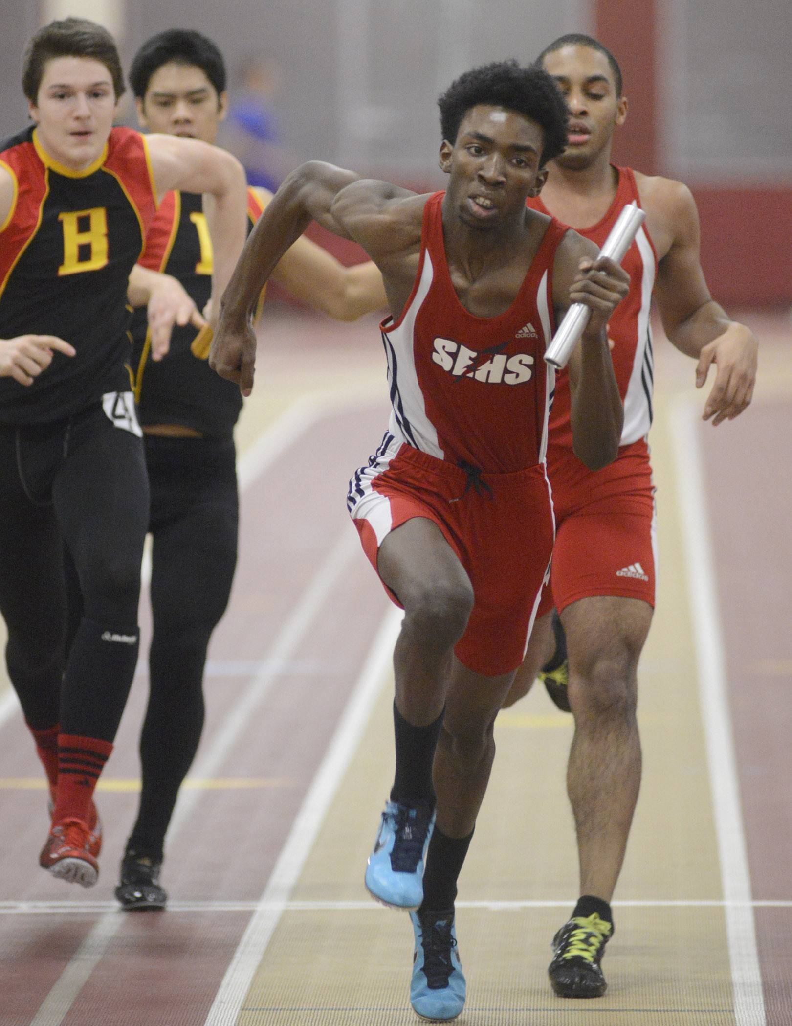 South Elgin's Marshawn Lewis is handed the baton from teammate James Dockens in the final heat of the 800-meter relay at the Upstate Eight Conference indoor meet in Batavia last month.