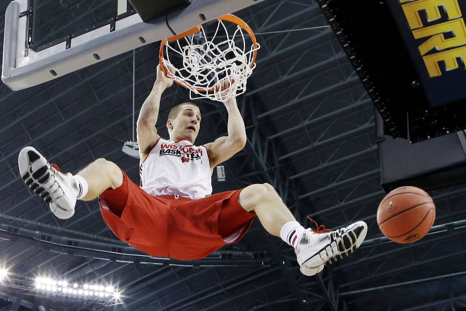 Wisconsin guard Ben Brust dunks during practice Friday in Dallas.