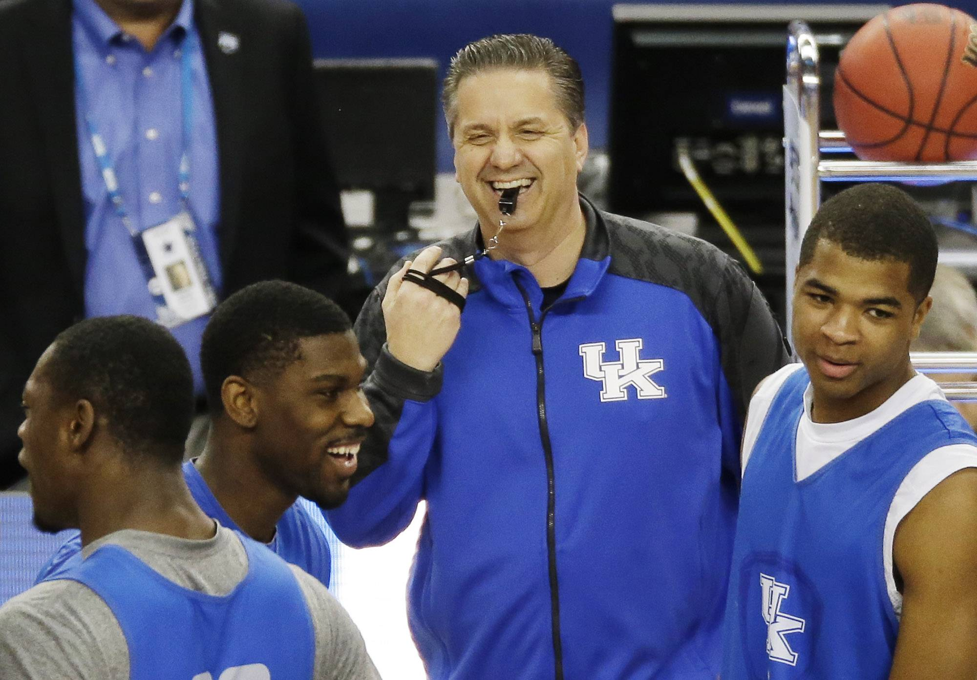 Kentucky head coach John Calipari shares a light moment with the team during practice Friday in Dallas.