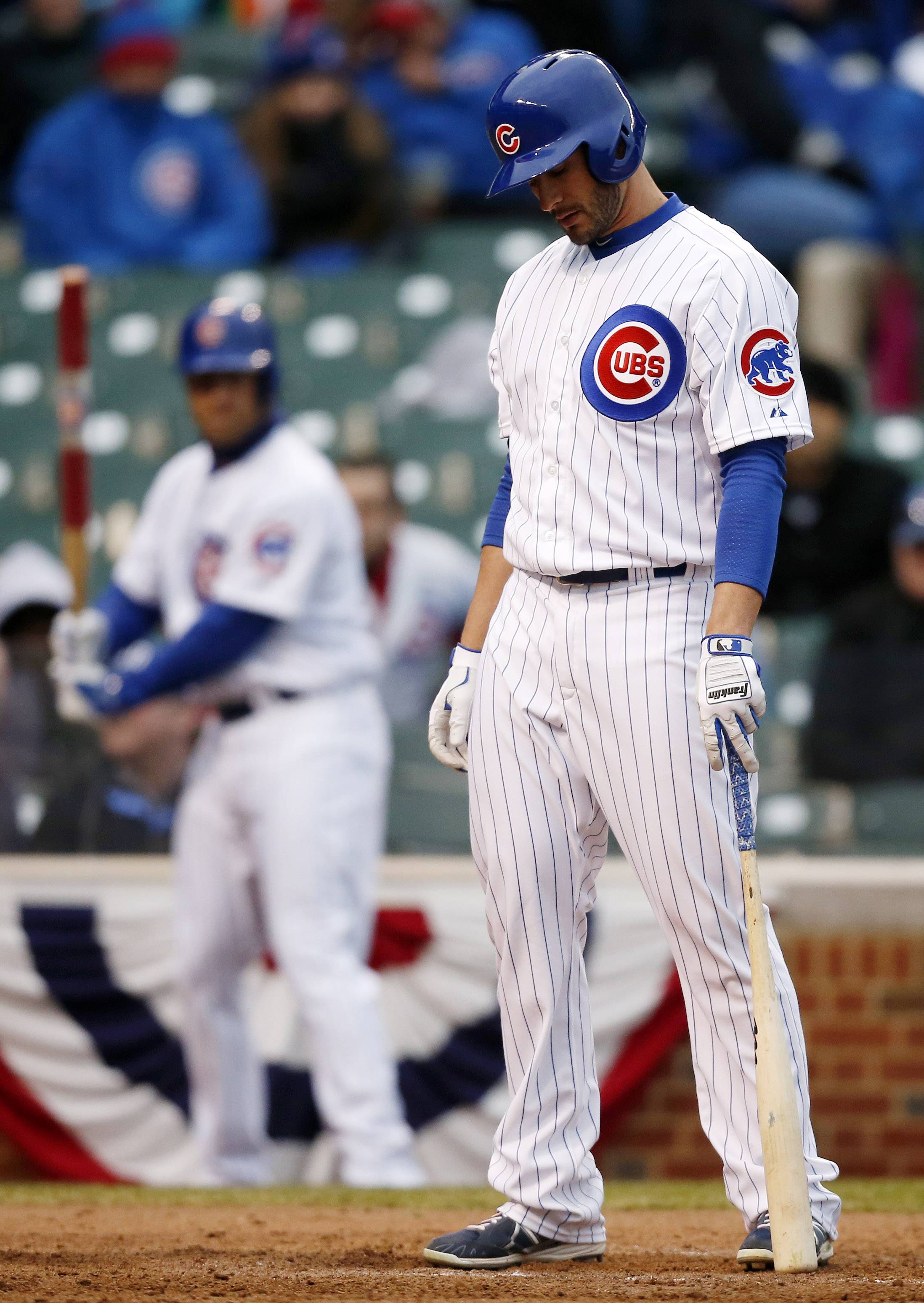 Chicago Cubs Justin Ruggiano reacts after striking out against the Philadelphia Phillies during the ninth inning of a baseball game on Friday, April 4, 2014, in Chicago.