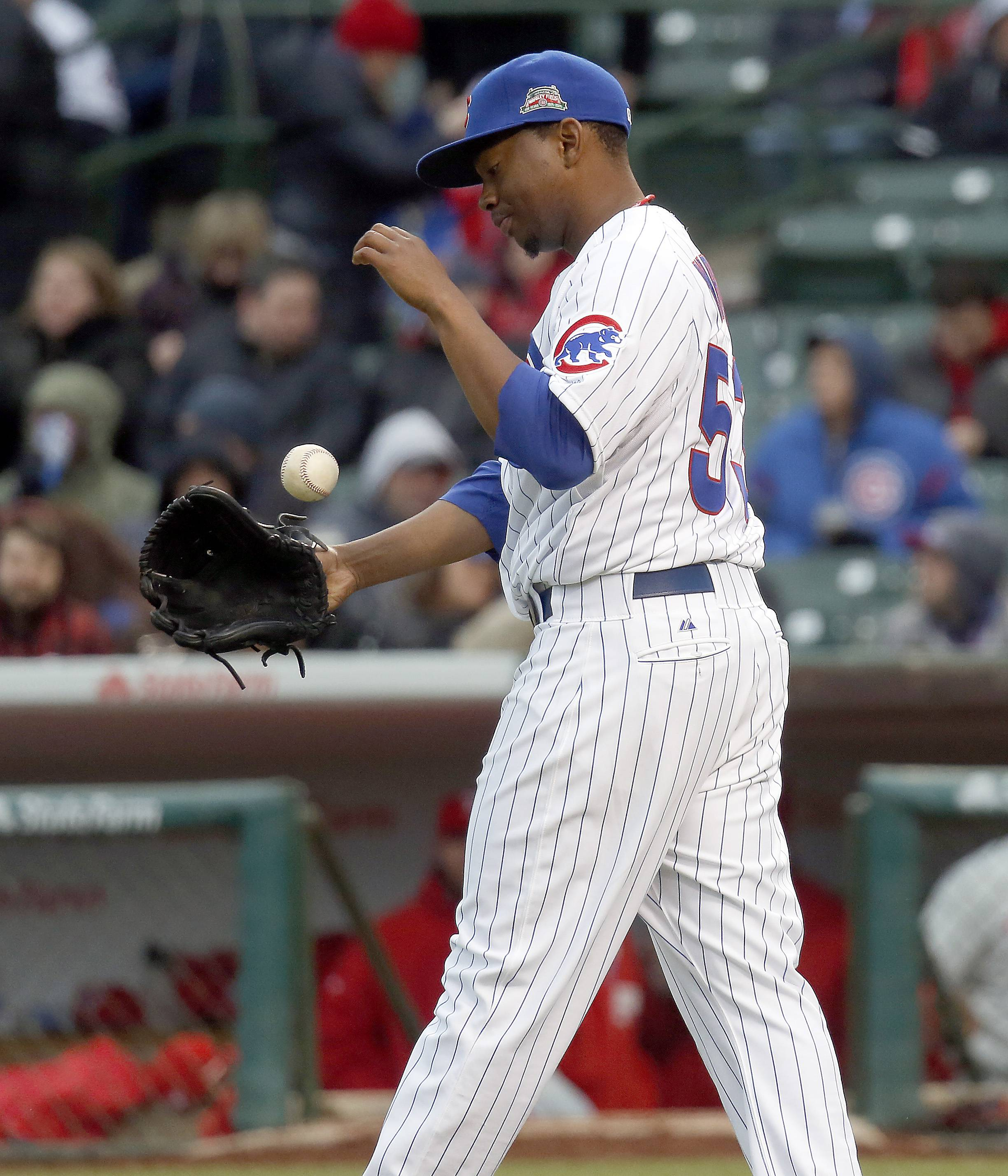 Chicago Cubs relief pitcher Wesley Wright reacts after giving up a two-run homer during the 8th inning.