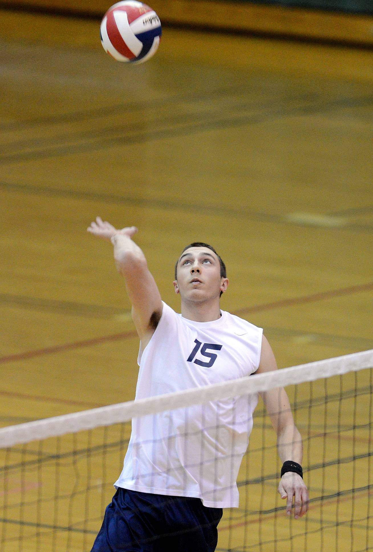 Bartlett's Mike Gulczynski goes up for a spike against IMSA during volleyball action Thursday at Bartlett.