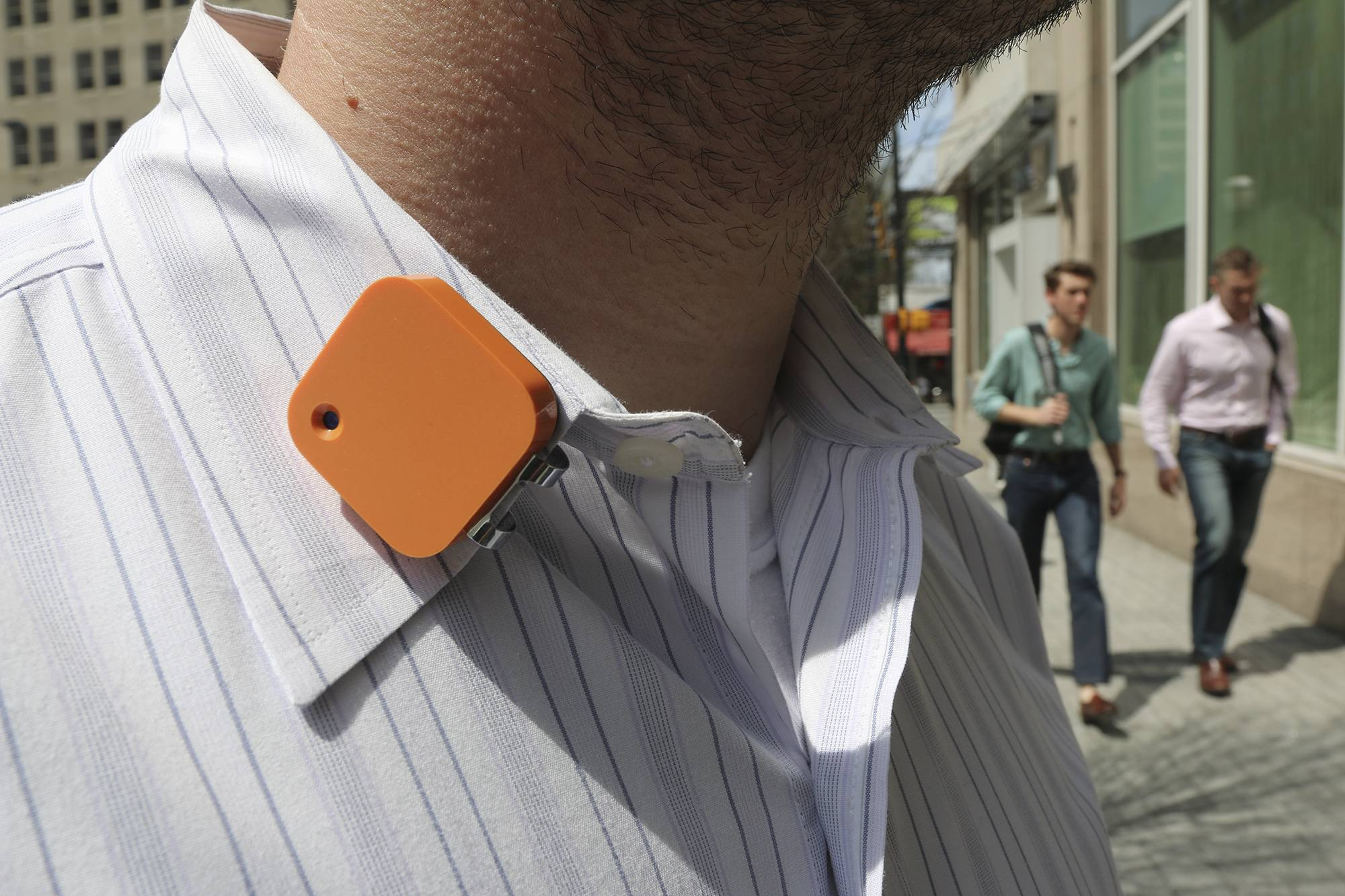 A Narrative Clip life-logging device is worn on a shirt collar Wednesday, April 2, 2014 in Atlanta. The small, wearable camera takes a photo automatically every 30 seconds.