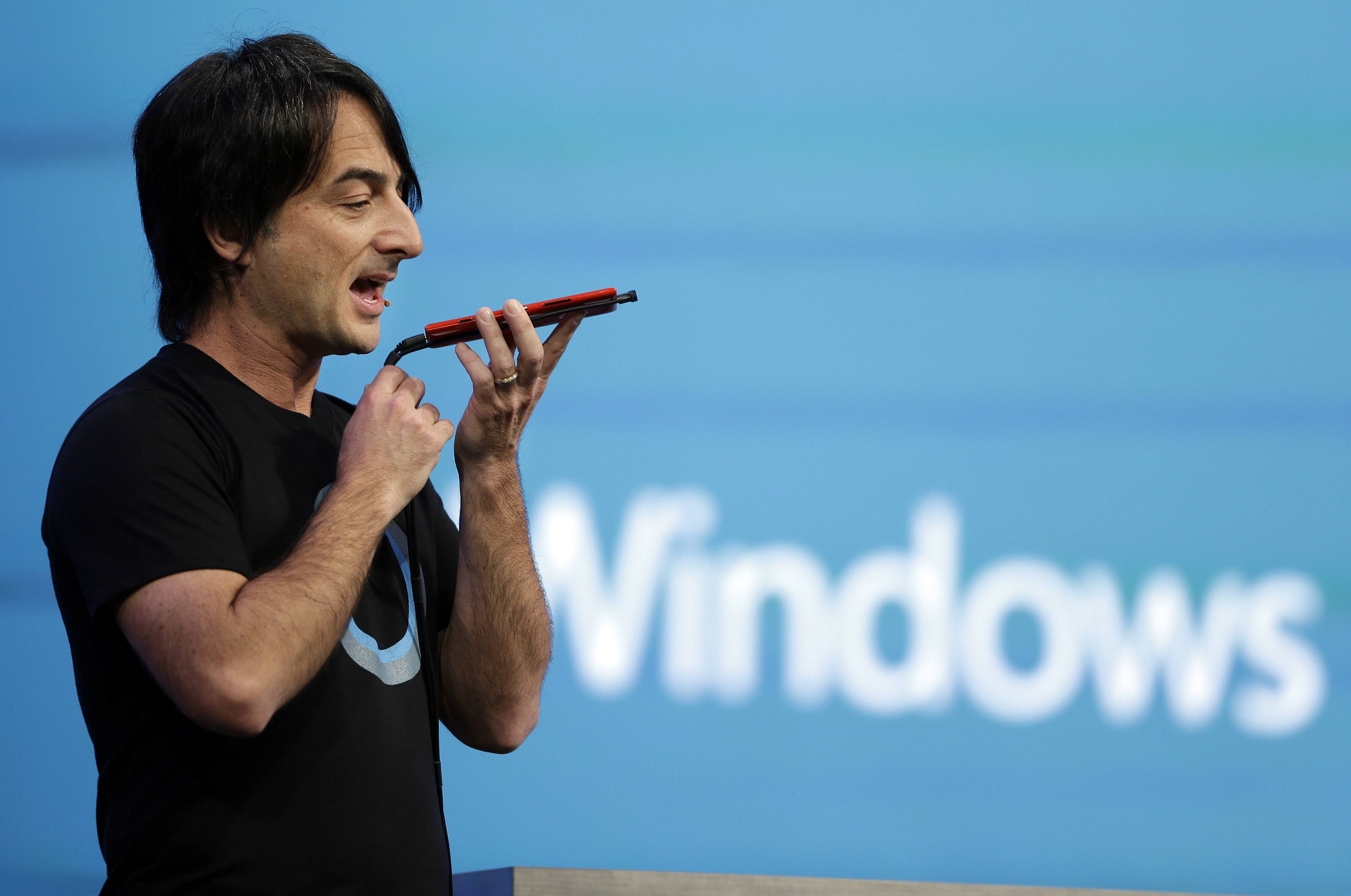 Microsoft corporate vice president Joe Belfiore, of the Operating Systems Group, demonstrates the new Cortana personal assistant during the keynote address of the Build Conference Wednesday, April 2, 2014, in San Francisco.