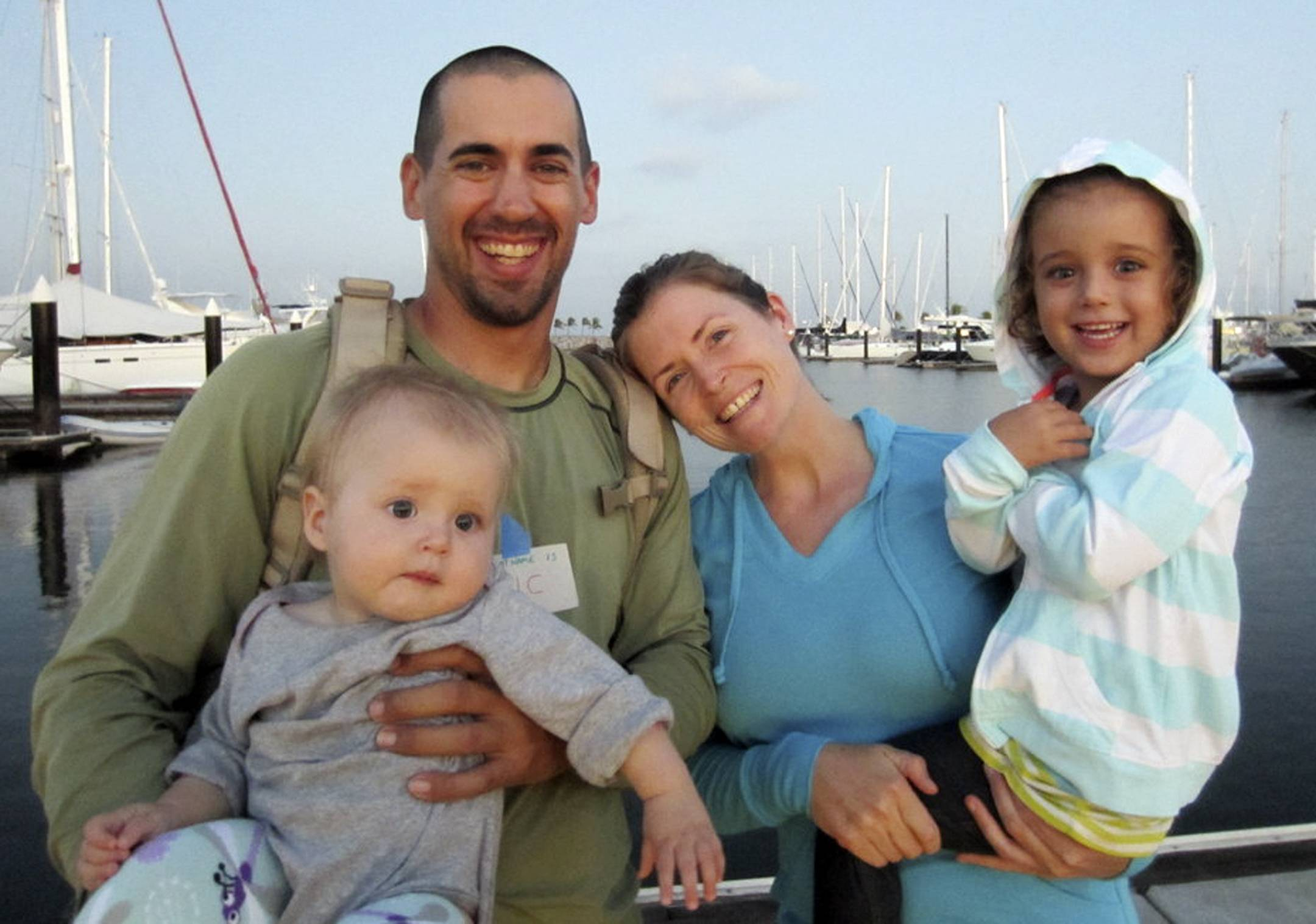 This undated image provided by Sariah English shows Eric and Charlotte Kaufman with their daughters, Lyra, 1, and Cora, 3. Rescuers have stabilized the condition of Lyra, with her family on a crippled sailboat hundreds of miles off the coast of Mexico, and a U.S. Navy warship was headed toward the vessel, officials said Friday night.