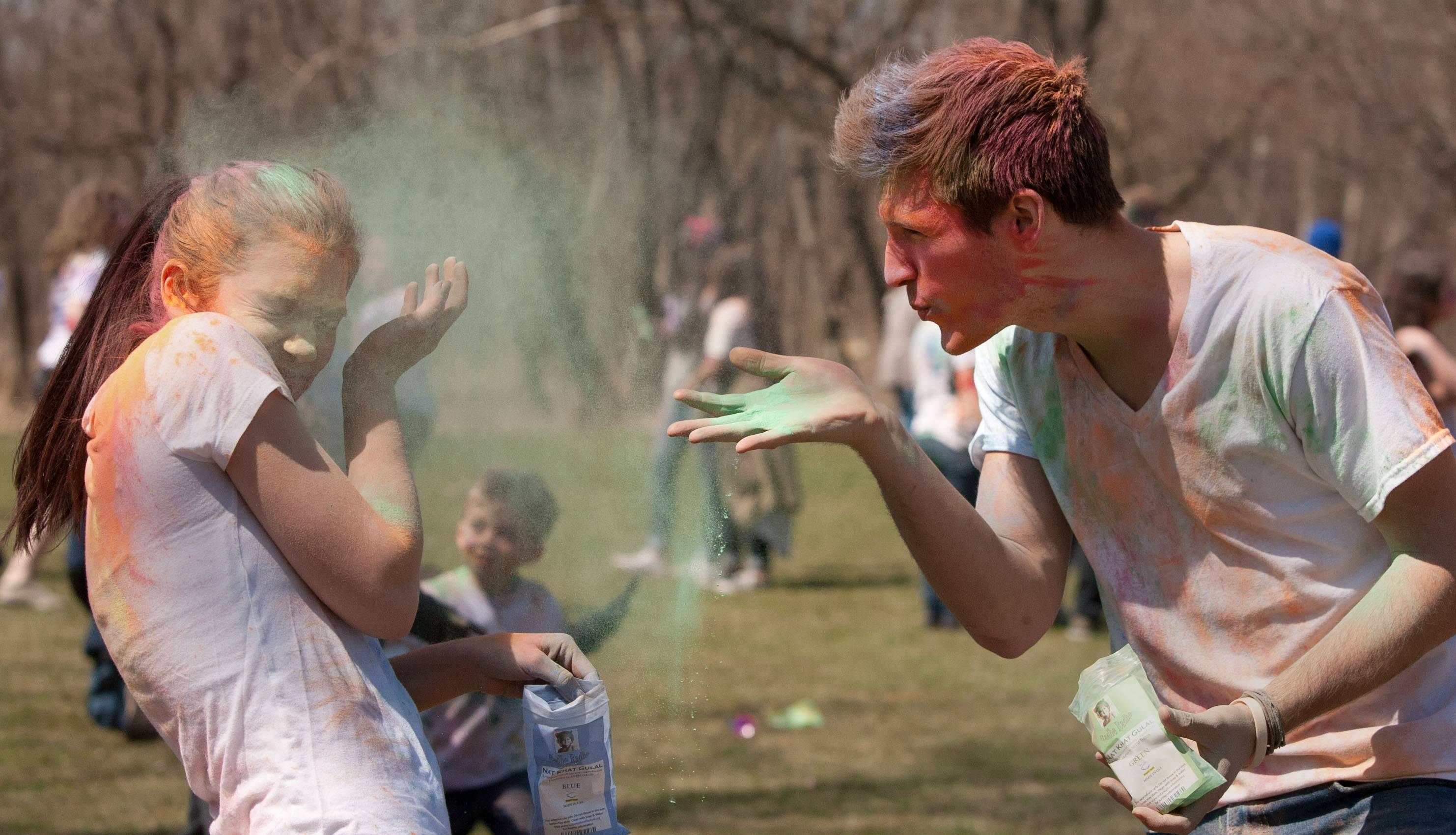 The Simply Vedic Cultural Society hosts the annual Festival of Colors in celebration of Holi, which rejoices at the arrival of spring. Participants like Natalie Barlowe of Glen Ellyn, left, and Danny Hochstatter, right, throw packets of colored powder/flour at each other in honor of the changing seasons in Naperville.
