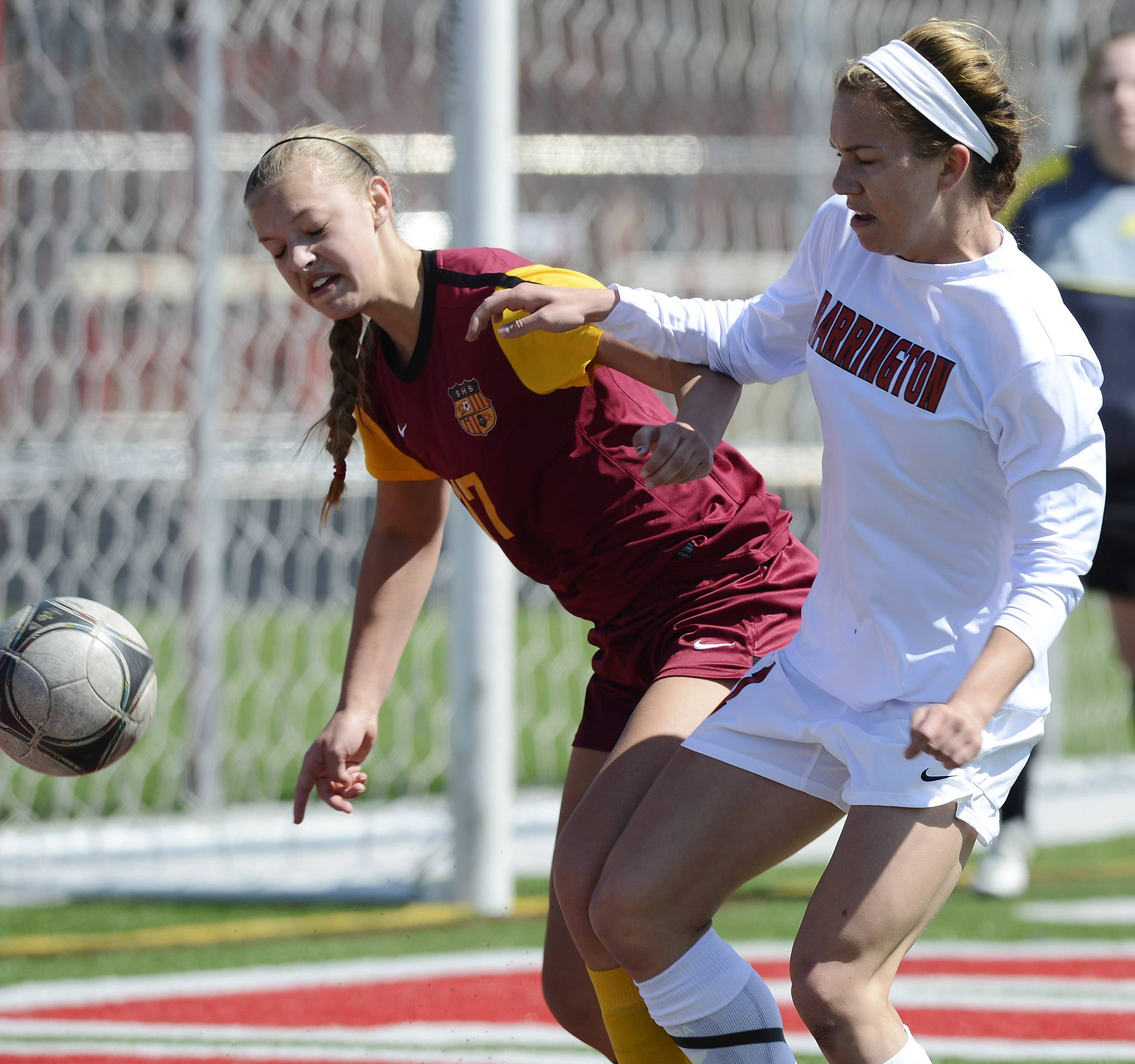 Schaumburg's Brittany Reinhart, left, and Barrington's Jenna Szczesny make contact as they pursue the ball during Saturday's game at Barrington.