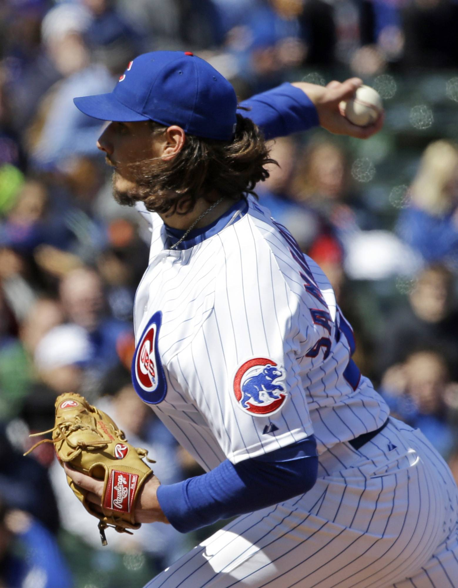 Chicago Cubs starter Jeff Samardzija throws against the Philadelphia Phillies during the first inning of a baseball game in Chicago, Saturday, April 5, 2014. (AP Photo/Nam Y. Huh)