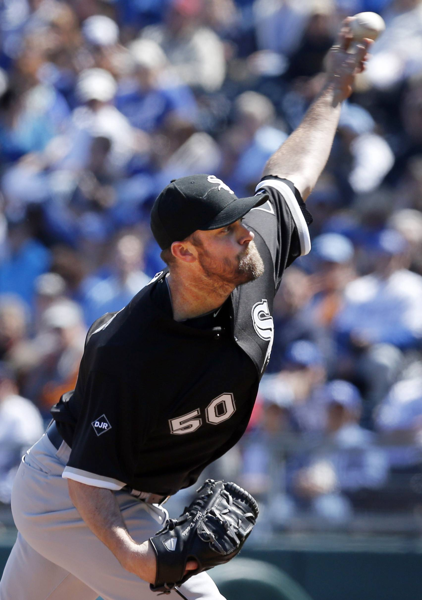 Chicago White Sox starting pitcher John Danks delivers to Kansas City Royals' Norichika Aoki during the first inning of a baseball game at Kauffman Stadium in Kansas City, Mo., Saturday, April 5, 2014. (AP Photo/Orlin Wagner)