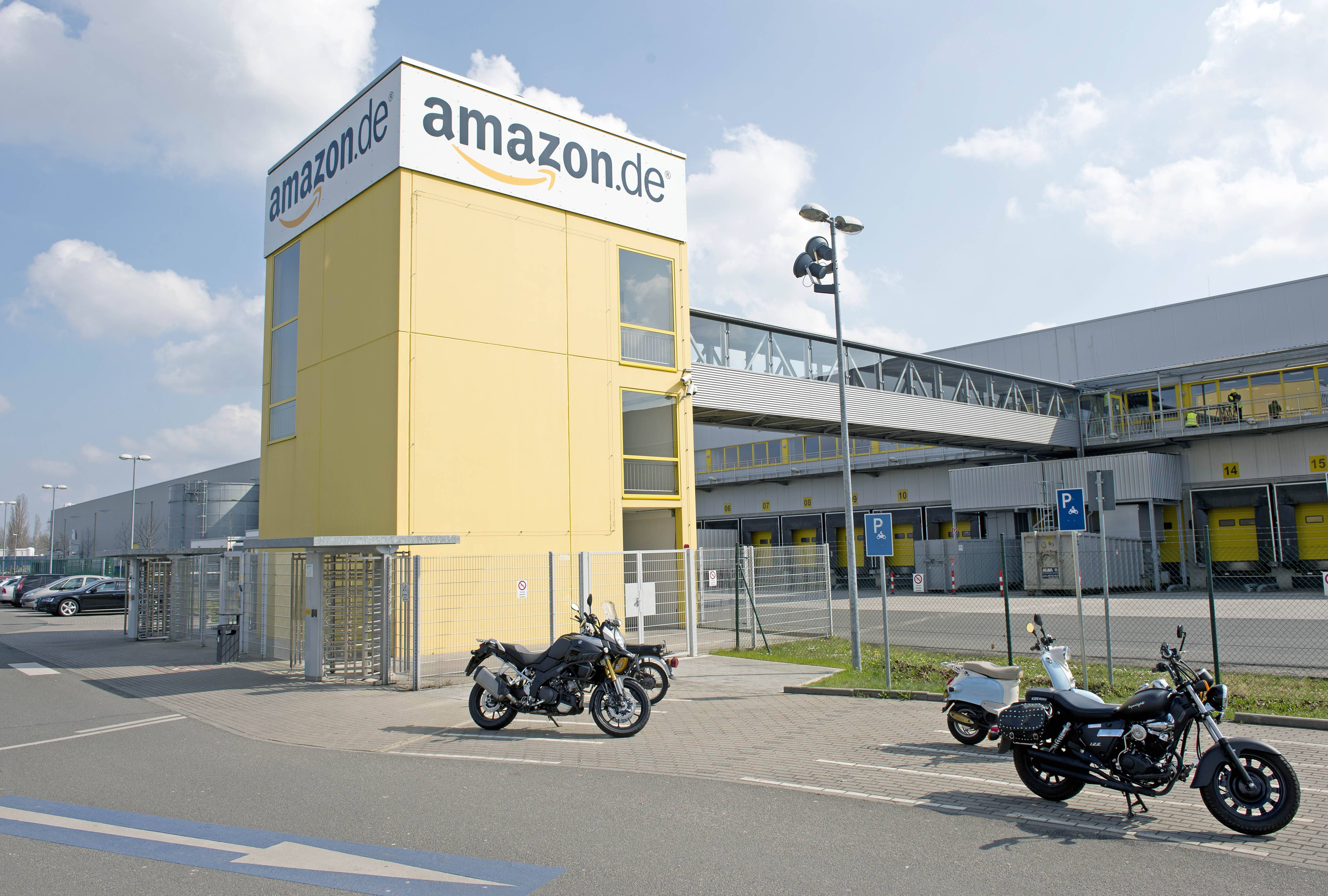 In this picture taken March 26, 2014, motorcycles stand in front of the distribution center of  online retailer Amazon in Leipzig, central Germany. Workers at one of Amazon.com's German distribution centers are on strike in a dispute over wages.. The ver.di union said Monday March 31, 2014  that workers at the American online retailer's logistics center in Leipzig were staging the short-term warning strike to try to get management to return to the negotiating table. Ver.di says it may extend the action to other logistics centers, and is also threatening multiple-day strikes.