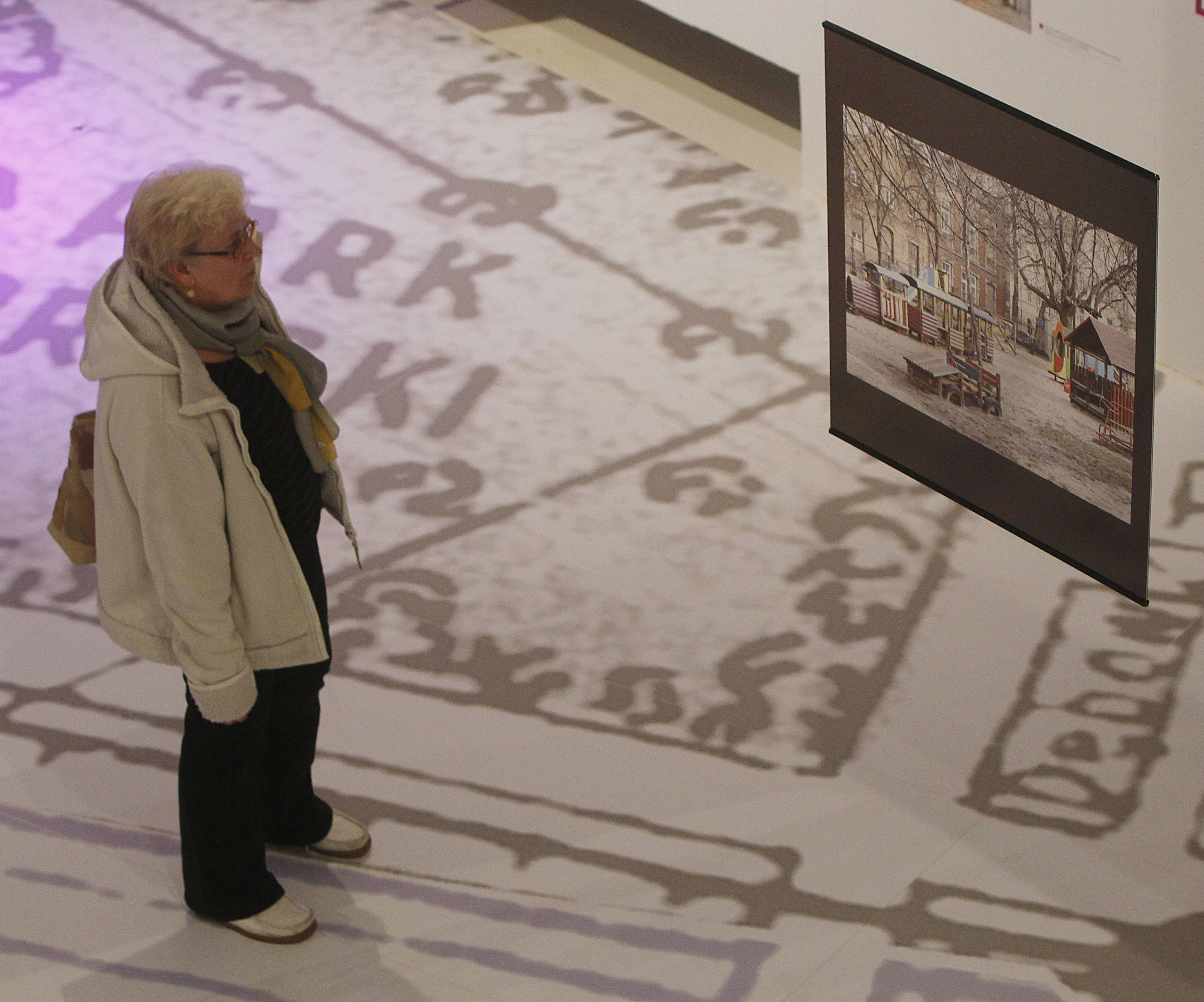 A visitor looks at a contemporary image of a site that used to be part of the Jewish district in pre-World War II Warsaw.