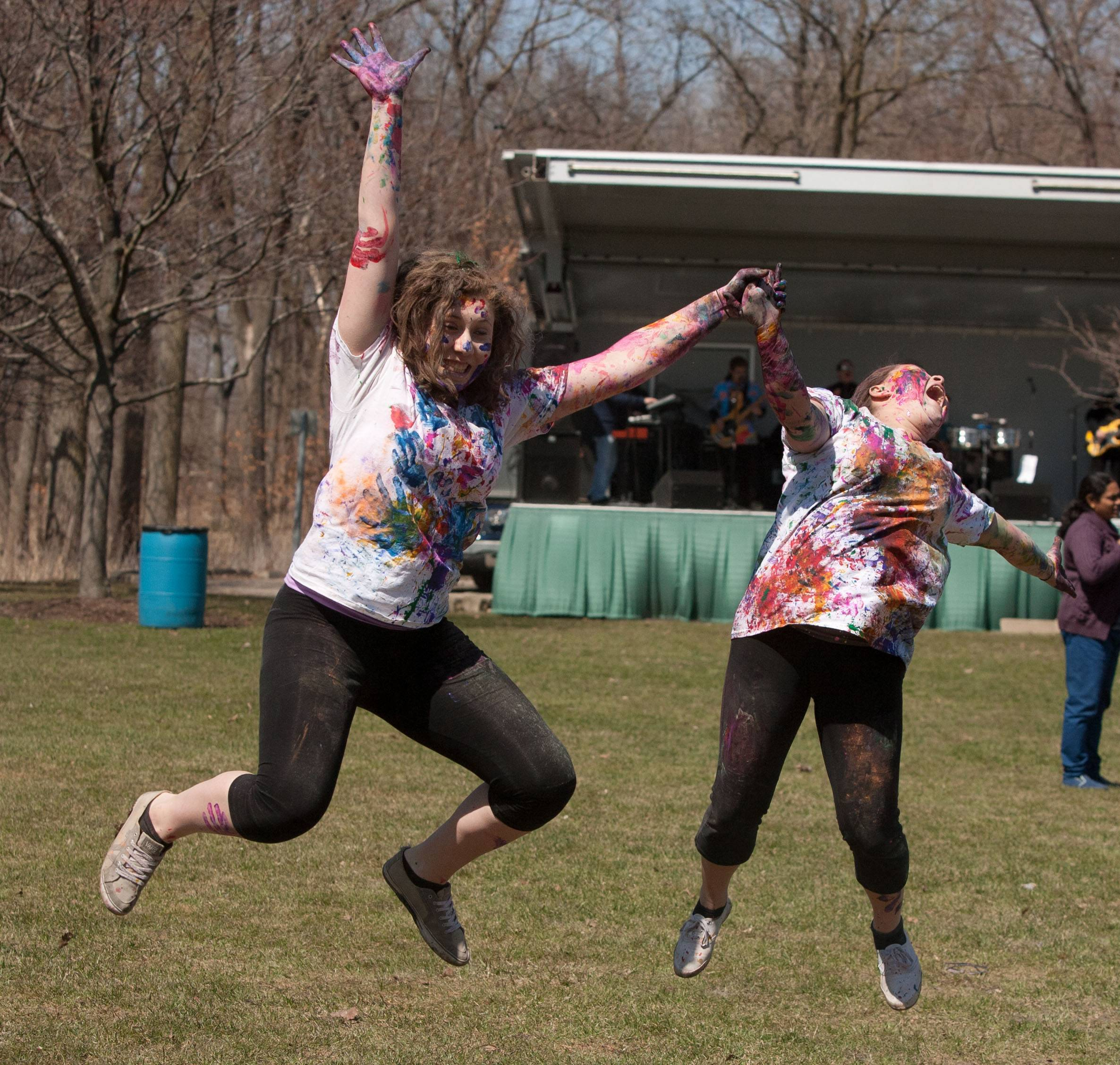 The Simply Vedic Cultural Society hosts the annual Festival of Colors in celebration of Holi, which rejoices at the arrival of spring. Participants like Hannah Brezinski and Michelle Holmes, both of Hanover Park, throw packets of colored powder/flour at each other in honor of the changing seasons in Naperville.