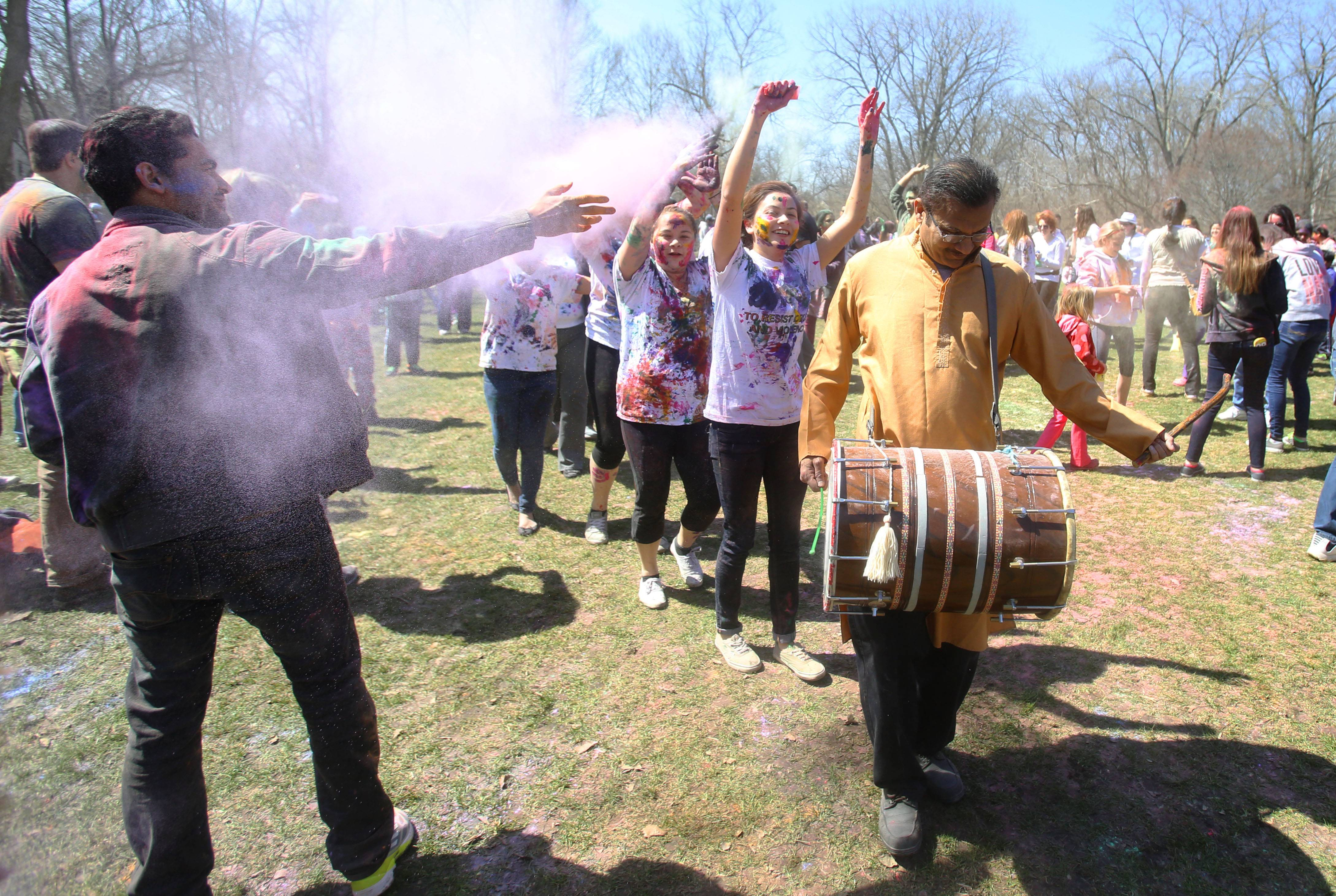 Dhol player Mehul Adhikari of Palatine leads the way as the Simply Vedic Cultural Society hosts the annual Festival of Colors in celebration of Holi. Participants throw packets of colored powder/flour at each other in honor of the changing seasons in Naperville.