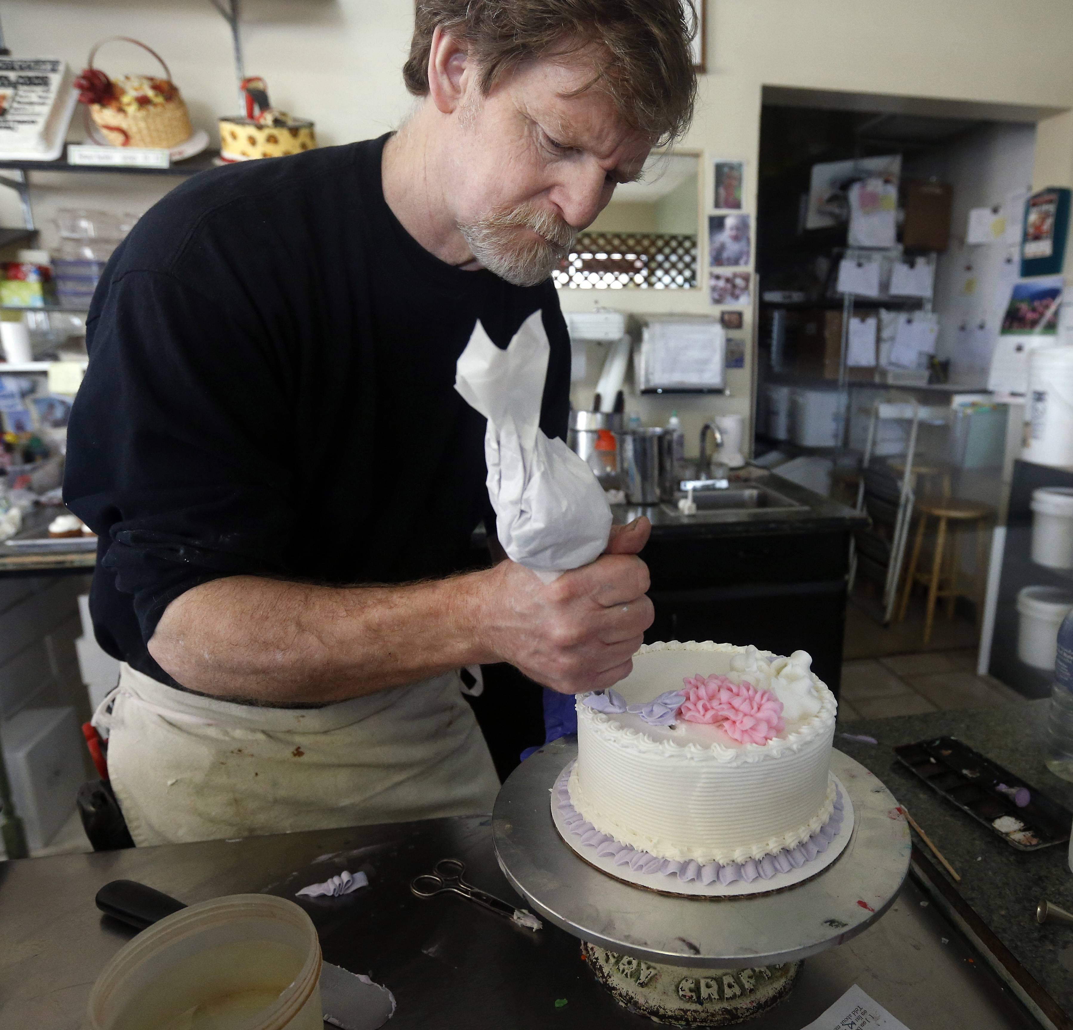 Masterpiece Cakeshop owner Jack Phillips decorates a cake inside his store in Lakewood, Colo. Phillips is appealing a recent ruling against him in a legal complaint filed with the Colorado Civil Rights Commission by a gay couple he refused to make a wedding cake for, based on his religious beliefs.