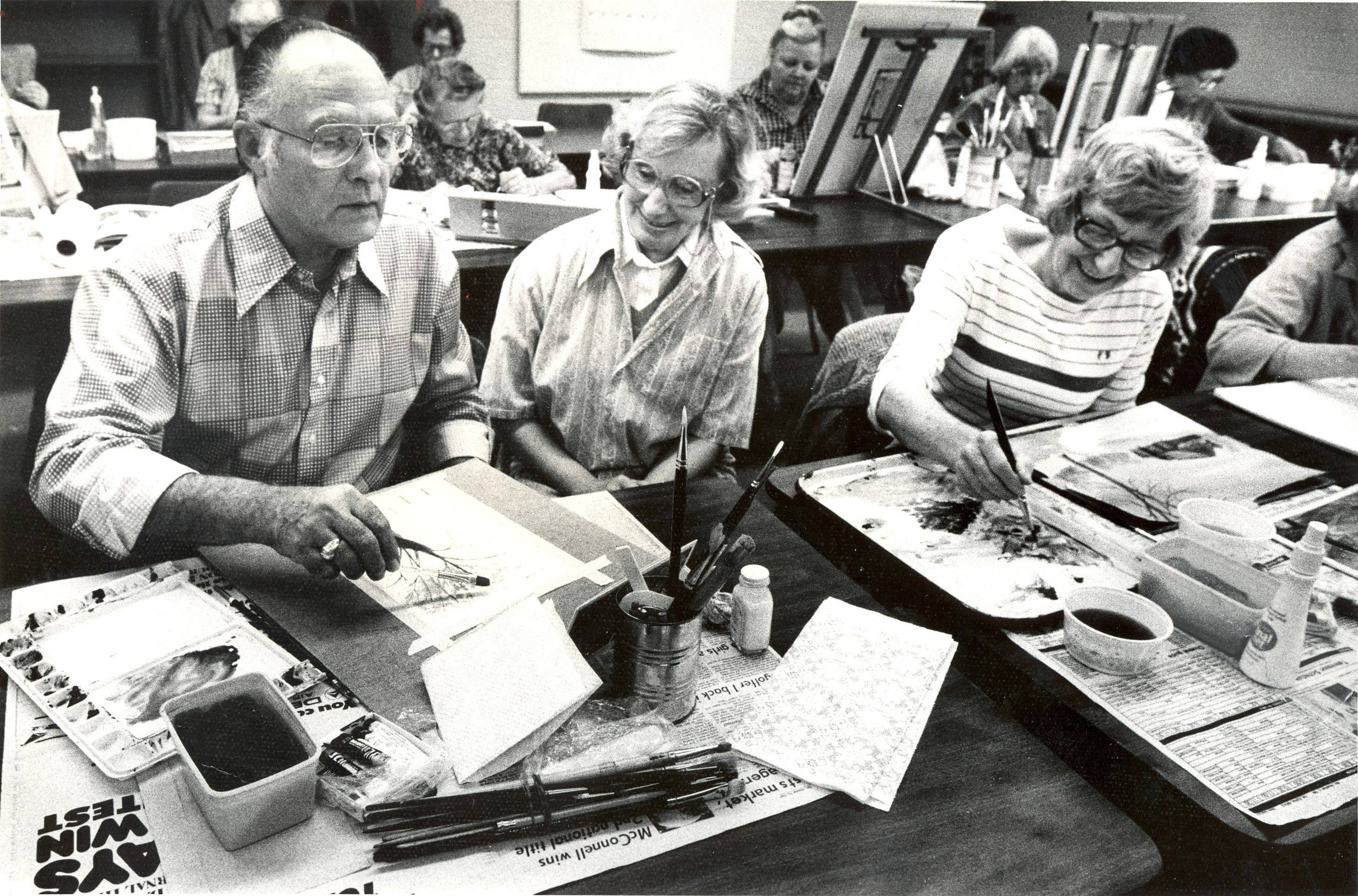 In this photo taken in November 1984, artist Richard Black, left, works with his class at Rosewood Art Centre in Kettering, Ohio.