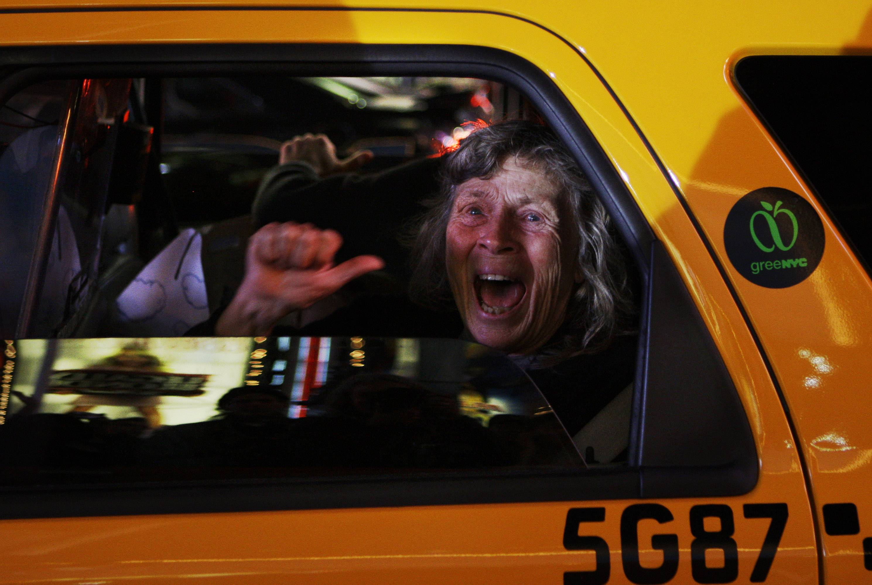 In this Tuesday, Nov. 4, 2008 file photo made by Associated Press photographer Anja Niedringhaus, a woman reacts while sitting in a New York taxi as different television networks call the presidential race for Barack Obama, in New York.